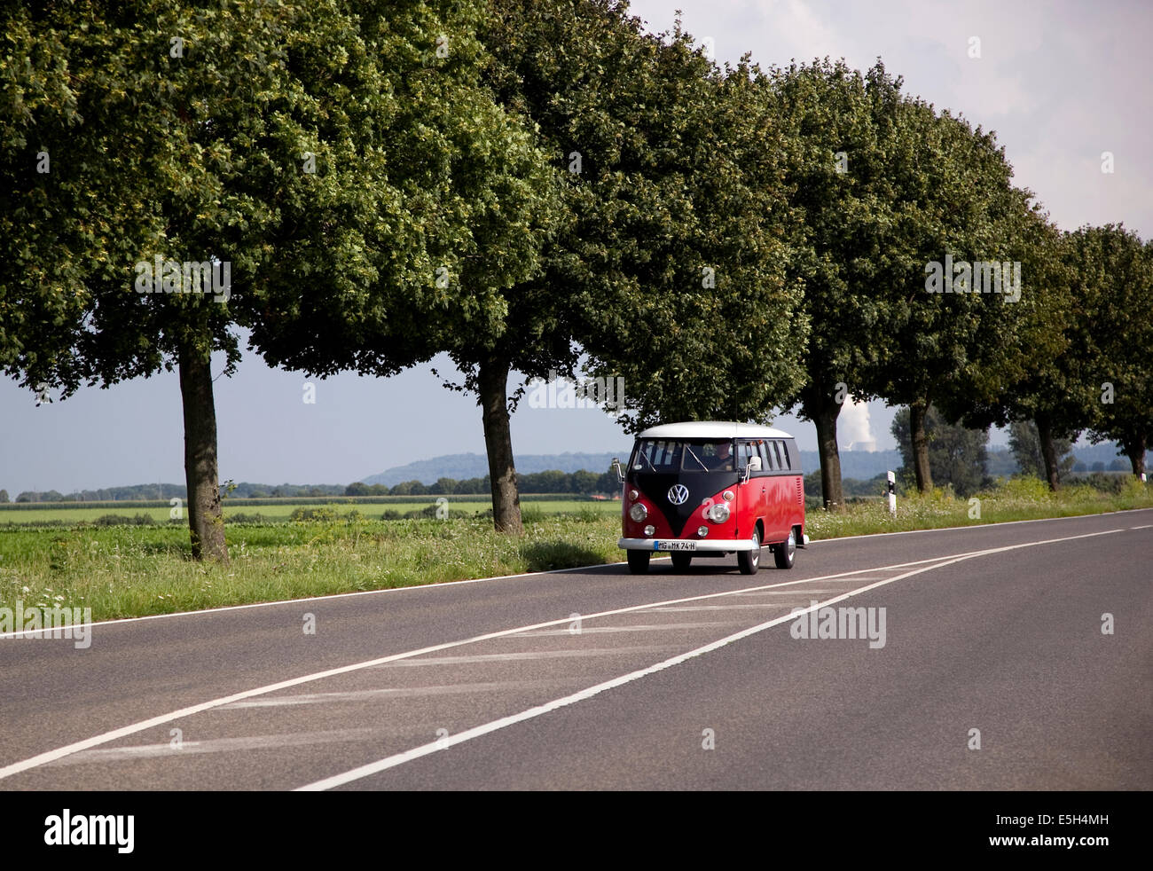 VW Microbus on a road in Germany - Stock Image