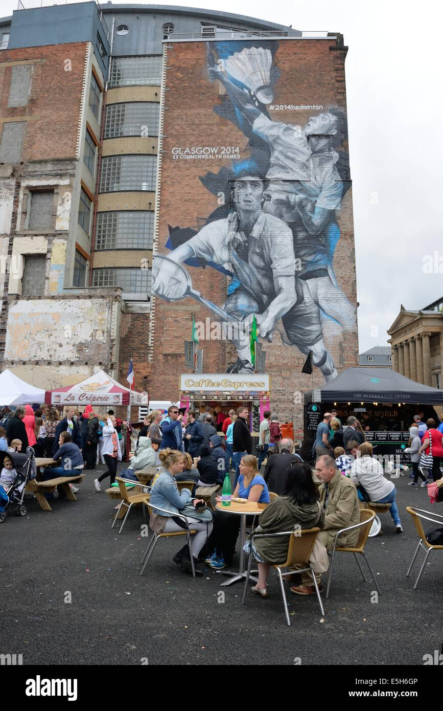 Merchant city festival and mural depicting the 2014 Glasgow Commonwealth Games - Stock Image