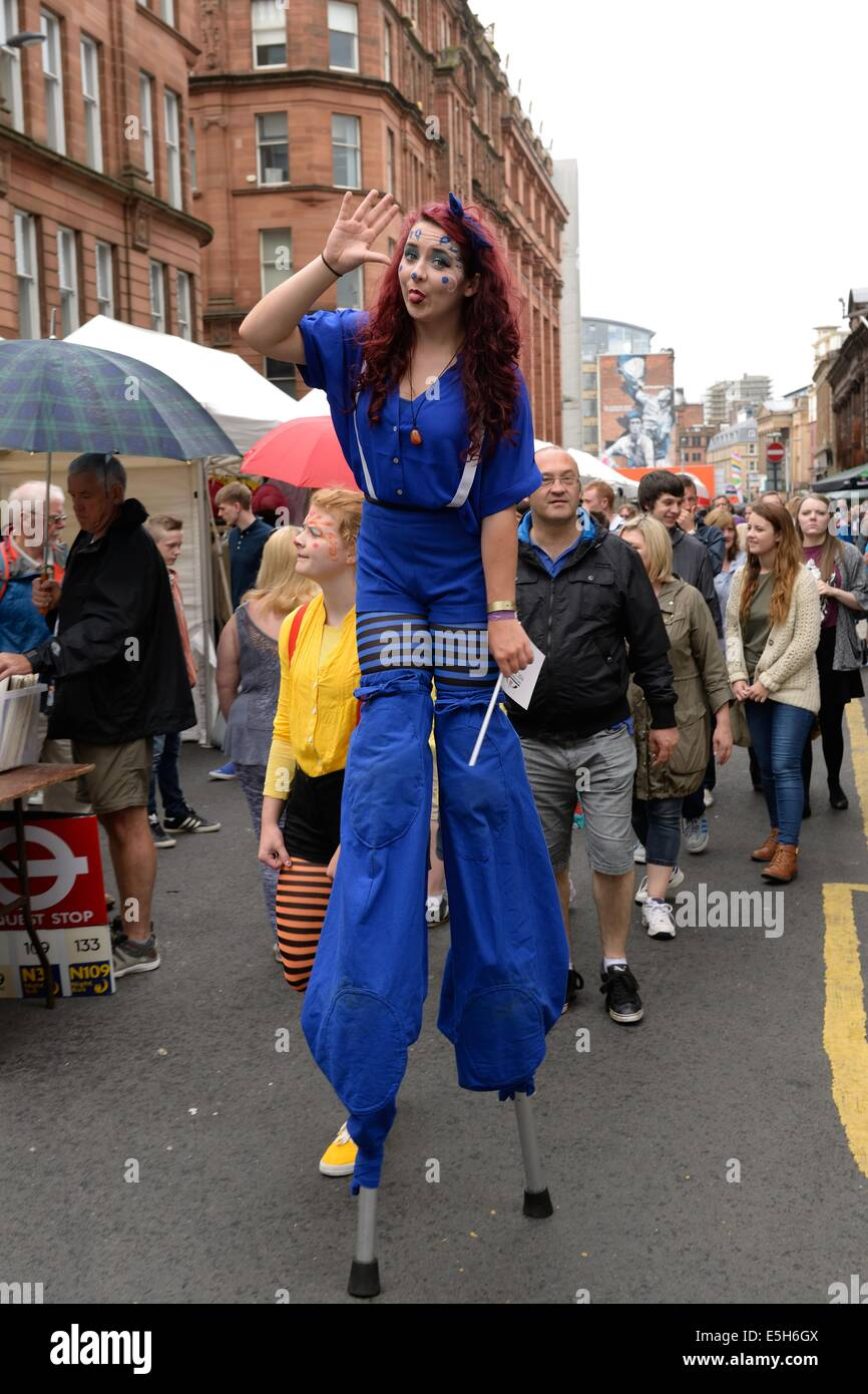 A street theatre girl on stilts at the Merchant city festival in Glasgow 2014 - Stock Image