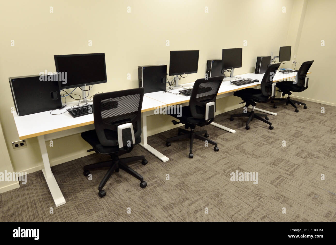 Computer Lab Room With Empty Workstation Office Desk And Chairs Stock Photo Alamy