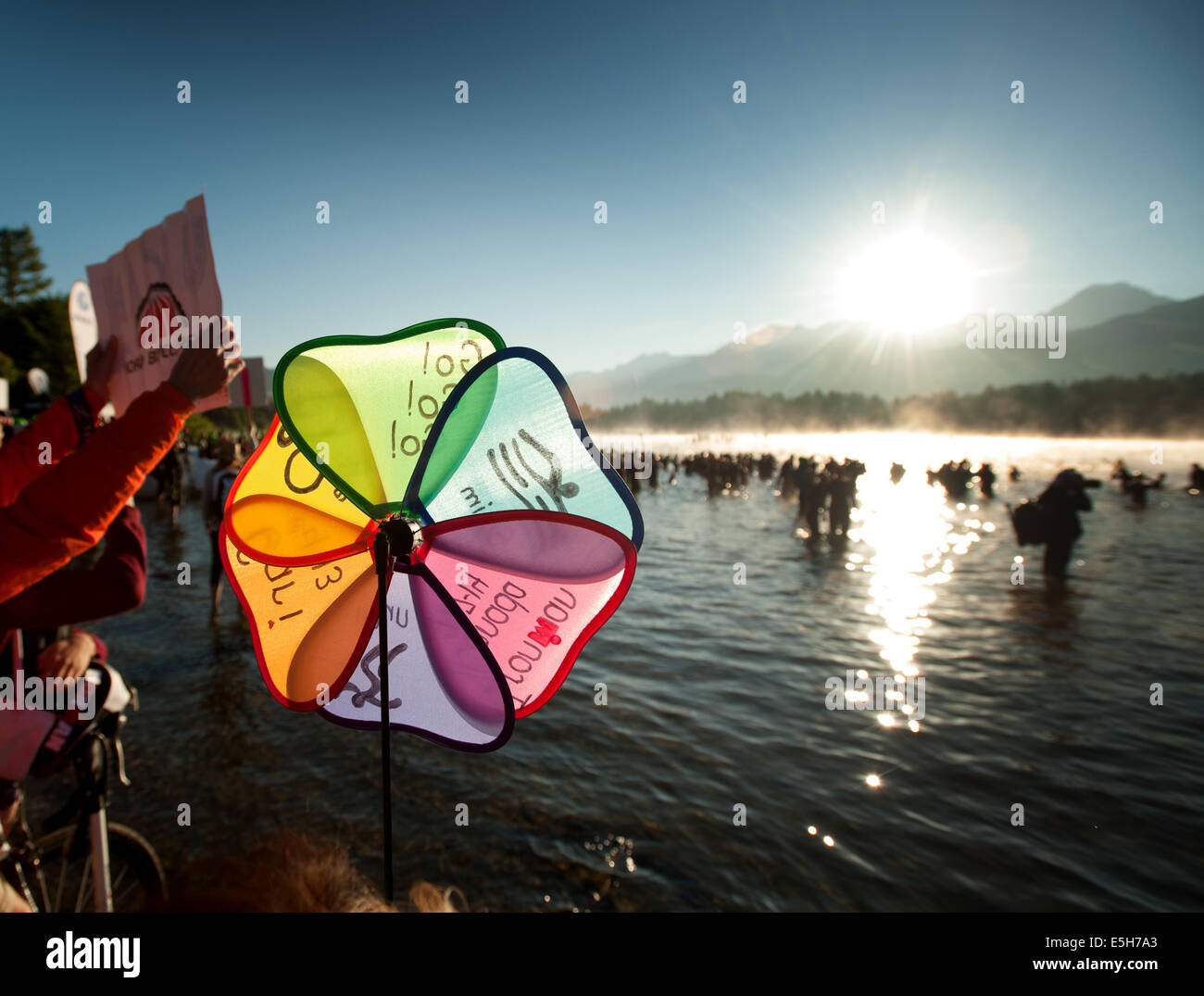 Swimmers enter the water at the start of the swim leg.  2014 Canadian Ironman.  Whistler BC, Canada.  July 27th, - Stock Image