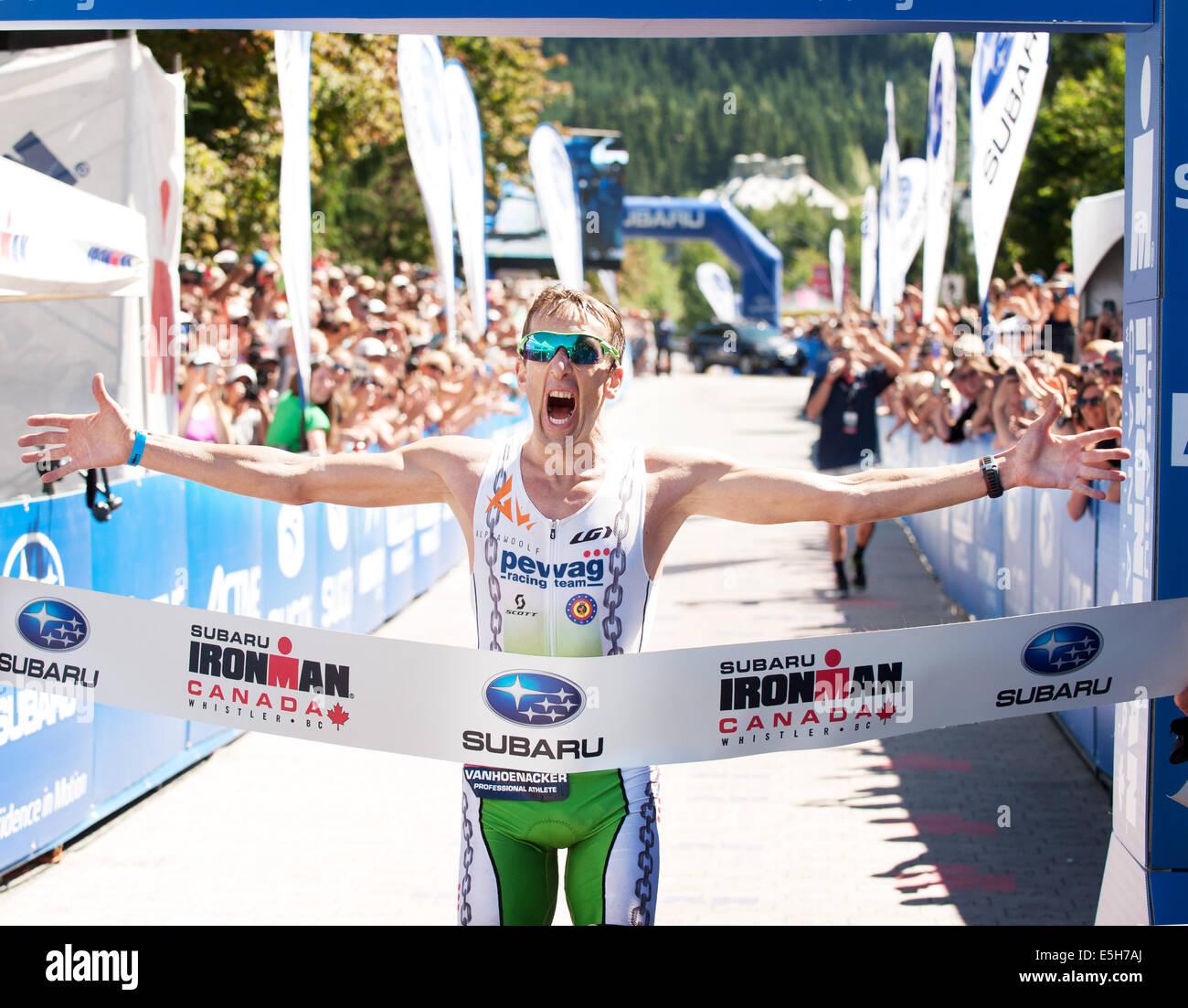 Winner Marino Vanhoenacker at the finish line.  2014 Canadian Ironman. - Stock Image