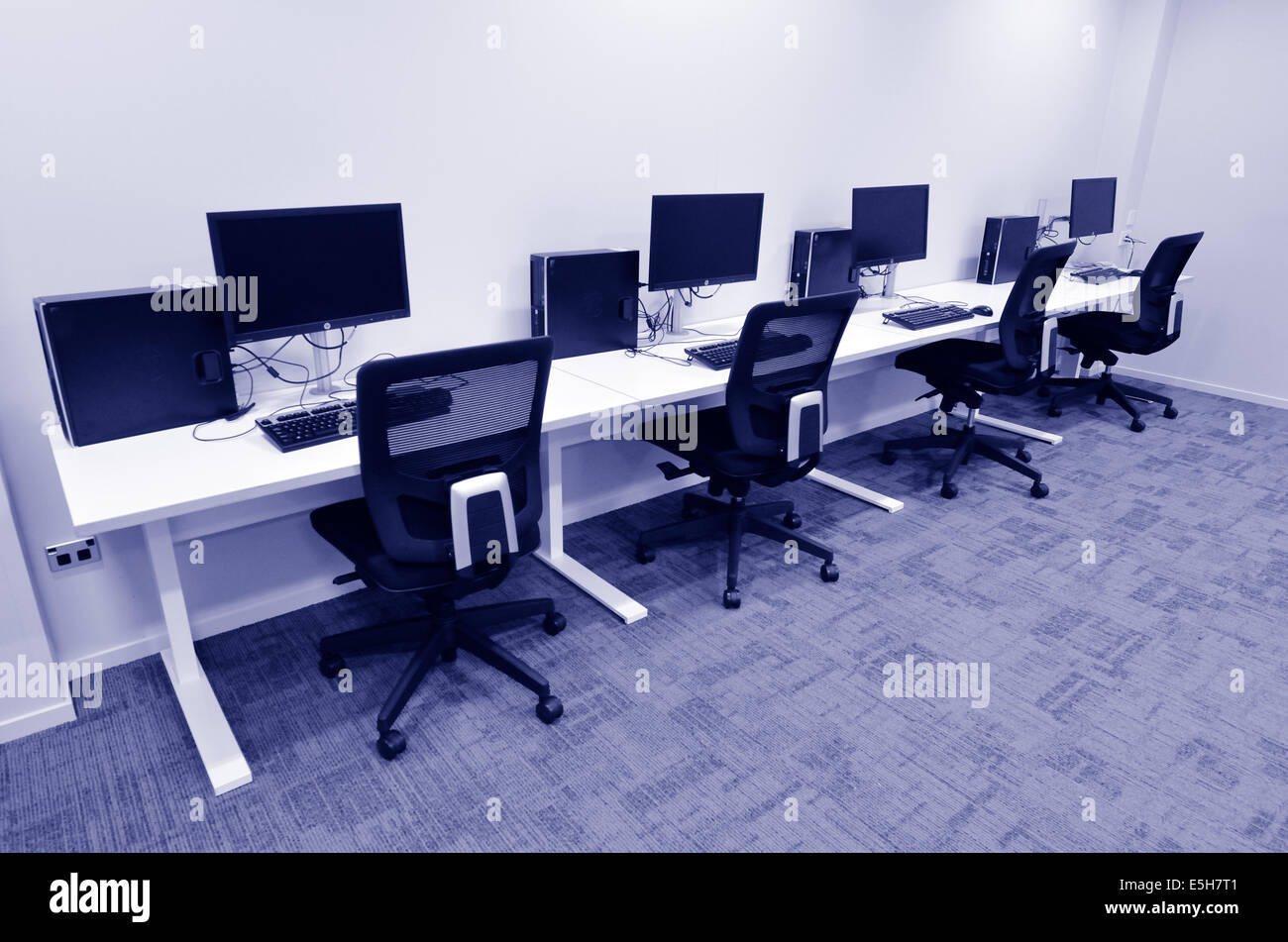 Computer Lab Room With Empty Workstation Office Desk And Chairs. Concept  Photo Of Business Workplace