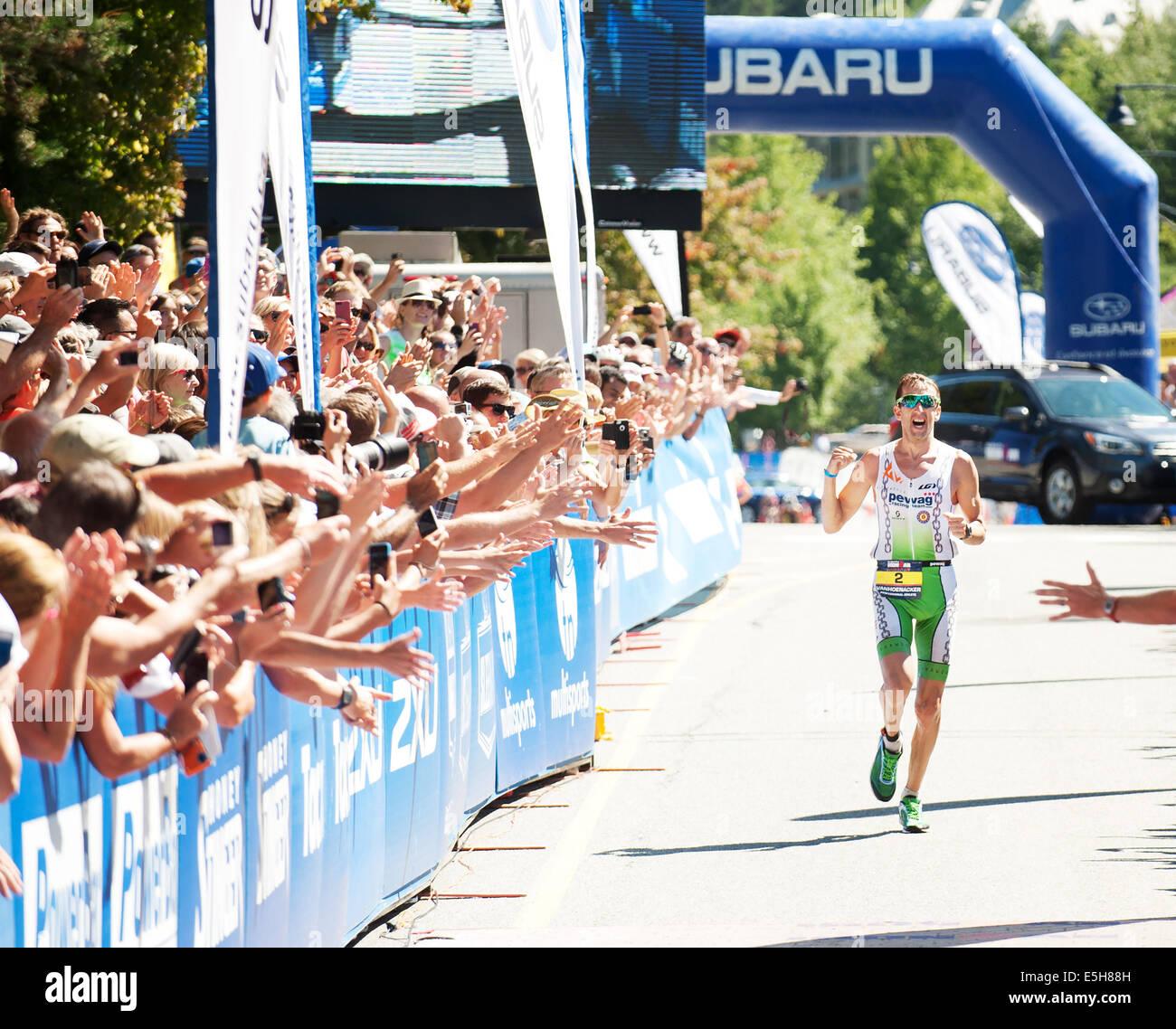 Winner Marino Vanhoenacker at the finish line.  2014 Canadian Ironman.  Whistler BC, Canada.  July 27th, 2014.  - Stock Image
