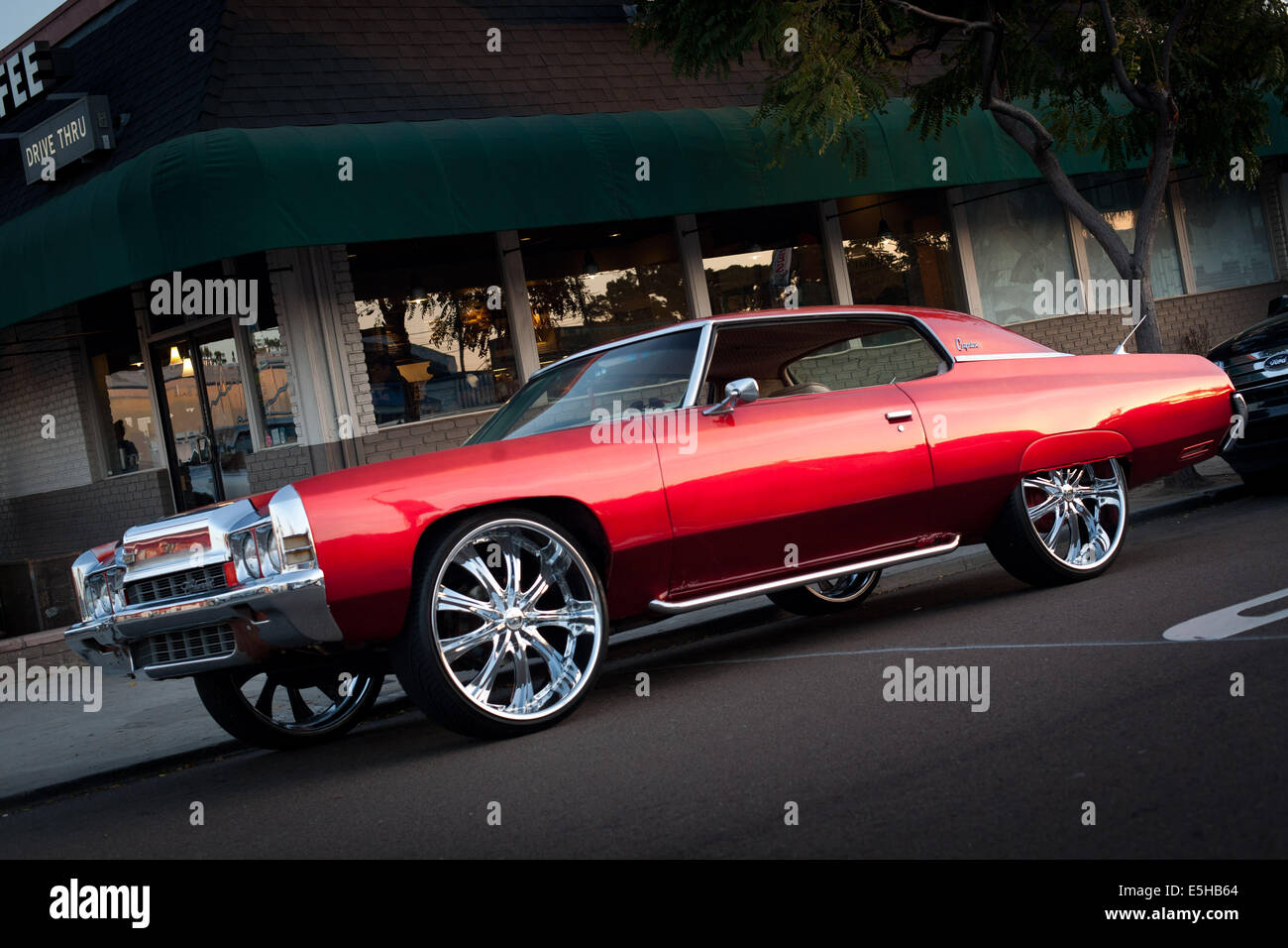 Chevrolet caprice stock photos chevrolet caprice stock images alamy chevrolet caprice with chrome plated star rims parked in front of a starbucks in publicscrutiny Choice Image