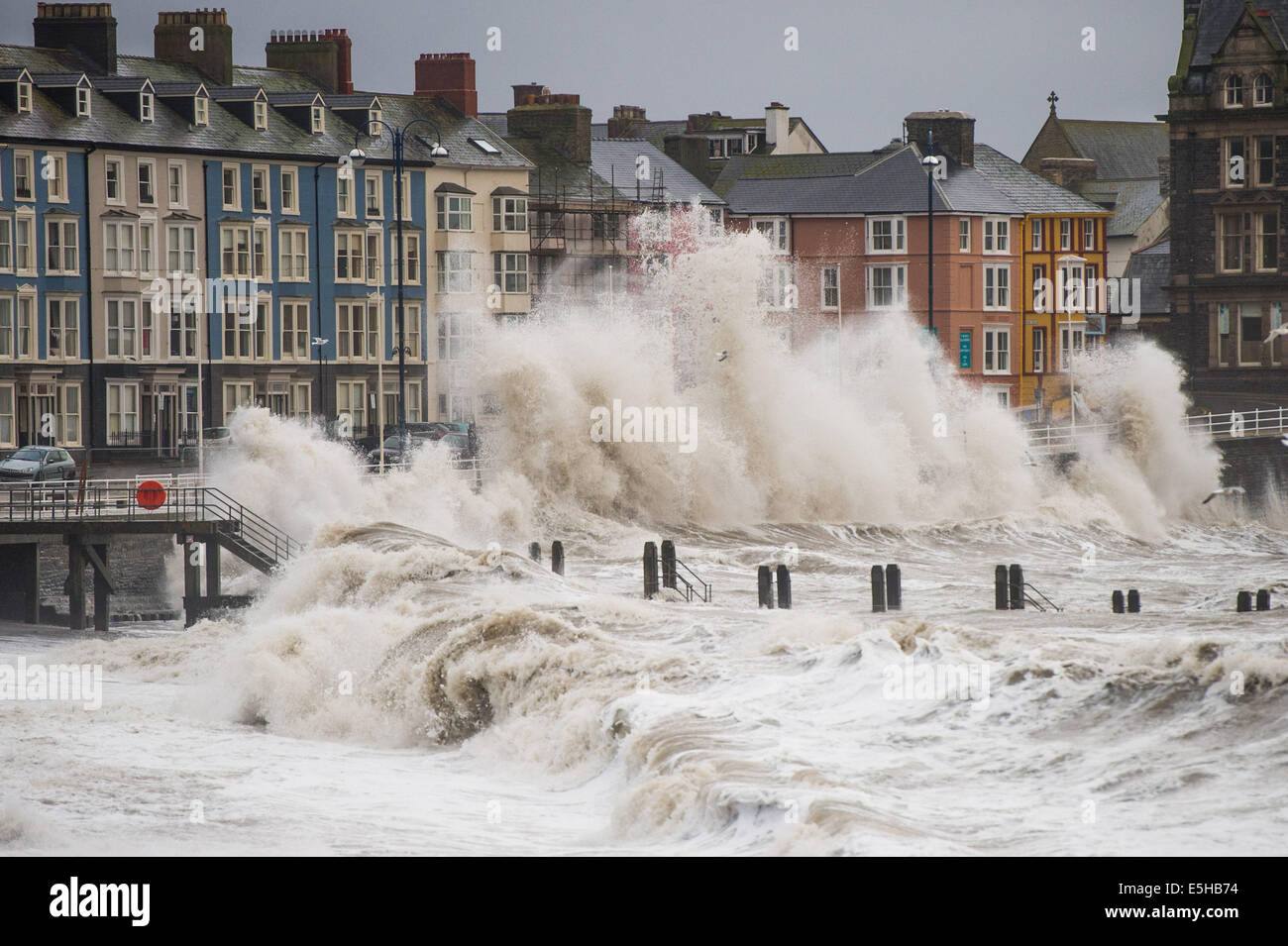 Aberystwyth, Wales, UK. 15 Feb 2014.  19-BEFORE: DURING THE STORMS. Winds gusting up to 60-70mph drive huge waves - Stock Image
