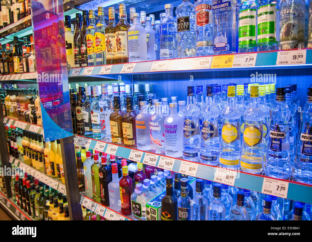 Shelf with a large selection of spirits in the supermarket. Stock Photo