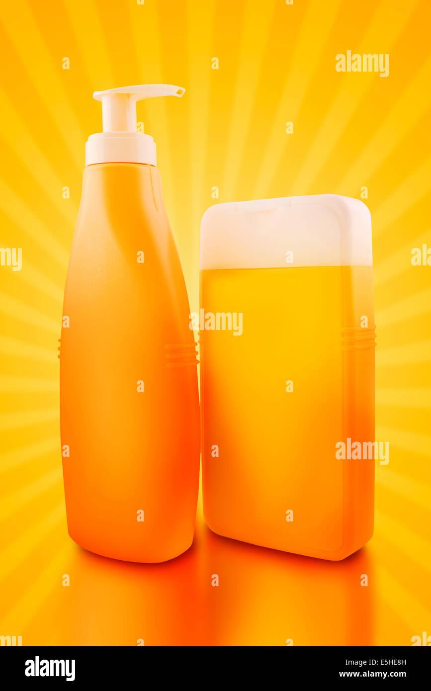 Sunbath oil or sunscreen bottles. Blank yellow plastic bottles. - Stock Image