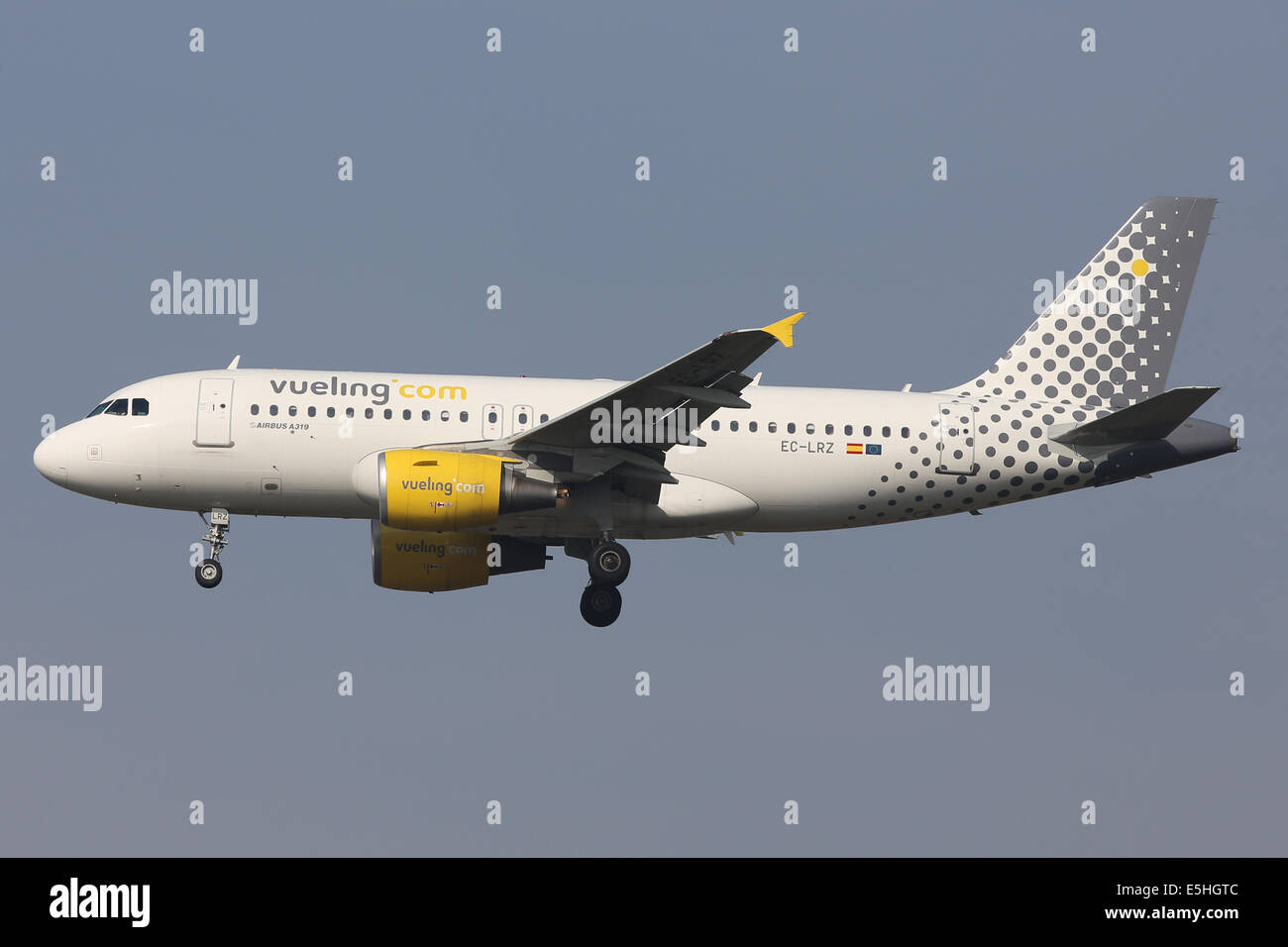 Vueling Airlines Airbus A319 arrives at London Heathrow from Barcelona, Spain - Stock Image