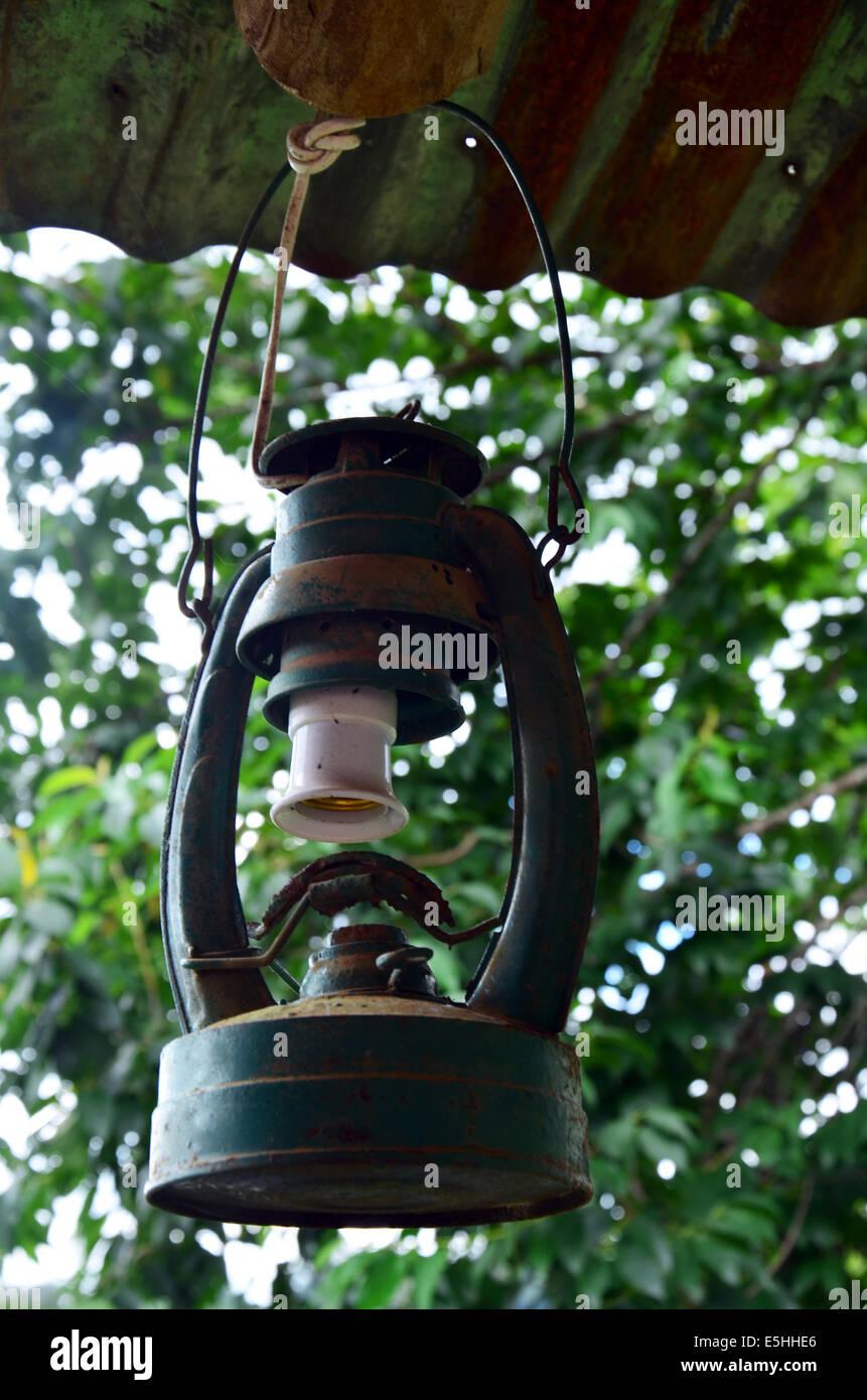 Broken Storm lantern or old Kerosene lamp - Stock Image
