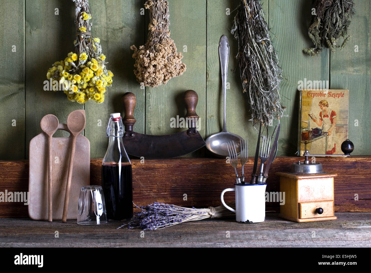 Rustic kitchen still life with kitchen utensils and dried herbs Stock Photo