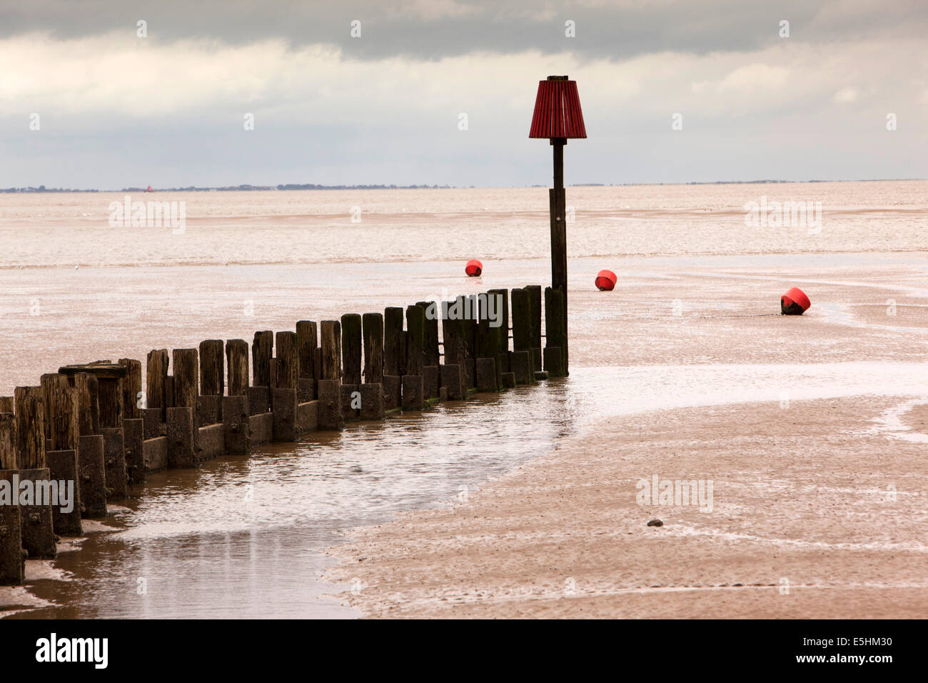 UK, England, Lincolnshire, Cleethorpes, breakwater beside pier on Humber Estuary - Stock Image