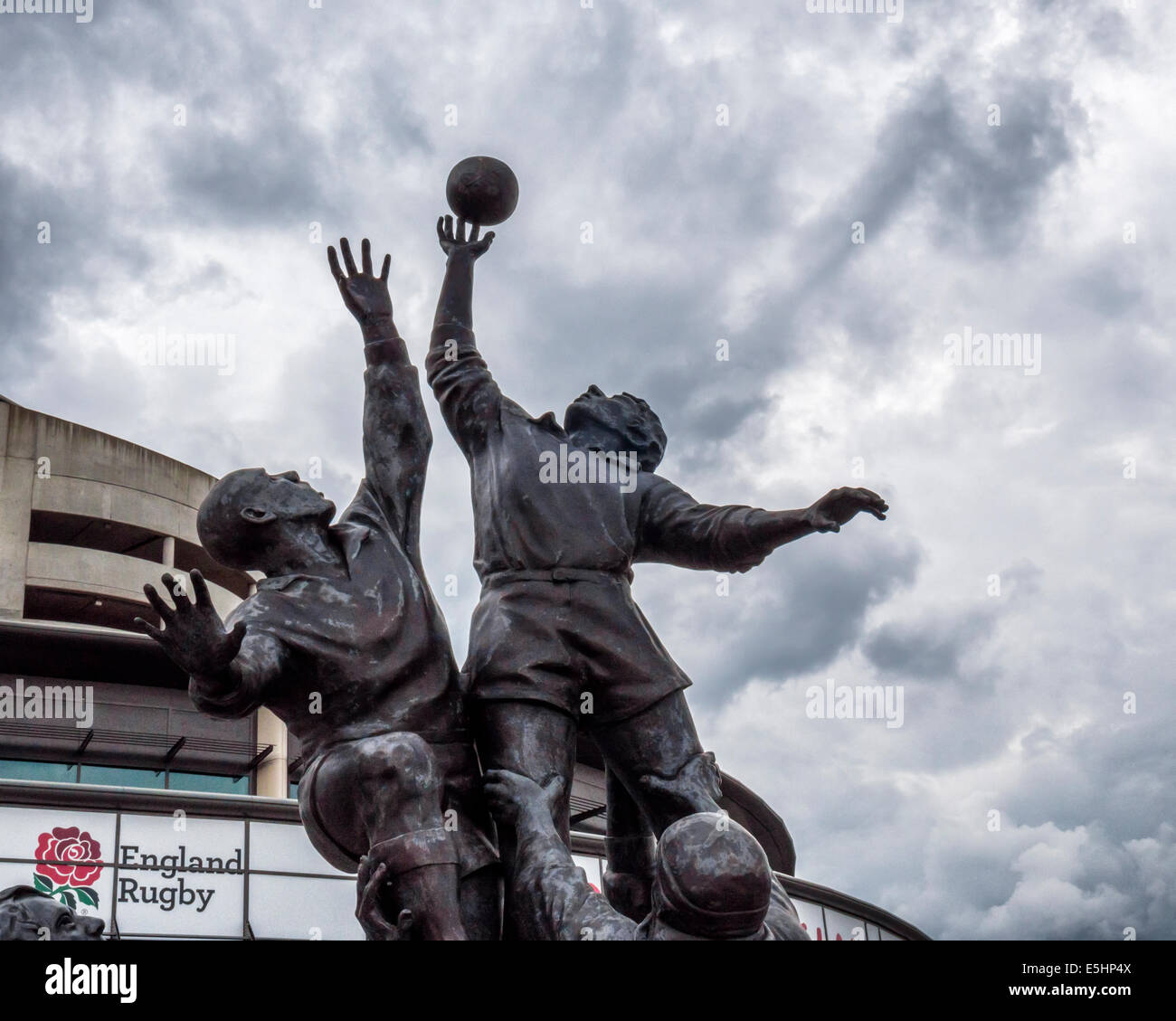 Twickenham Rugby Union stadium and bronze sculpture of Rugby players leaping for a rugby ball, London, England, - Stock Image