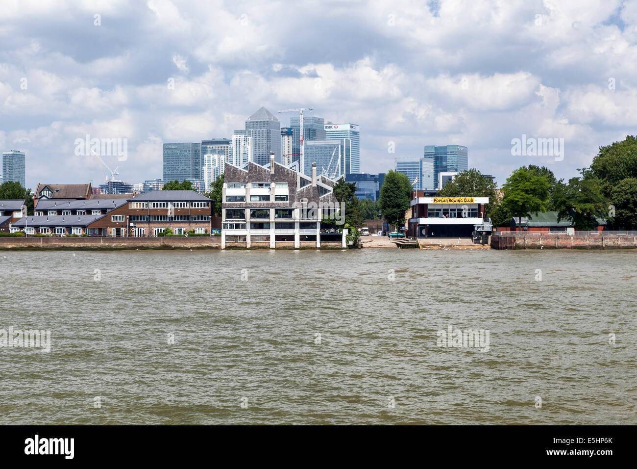 London skyline from Thames river - Canary Wharf Banking district, Isle of Dogs, Poplar rowing club. apartment buildings - Stock Image