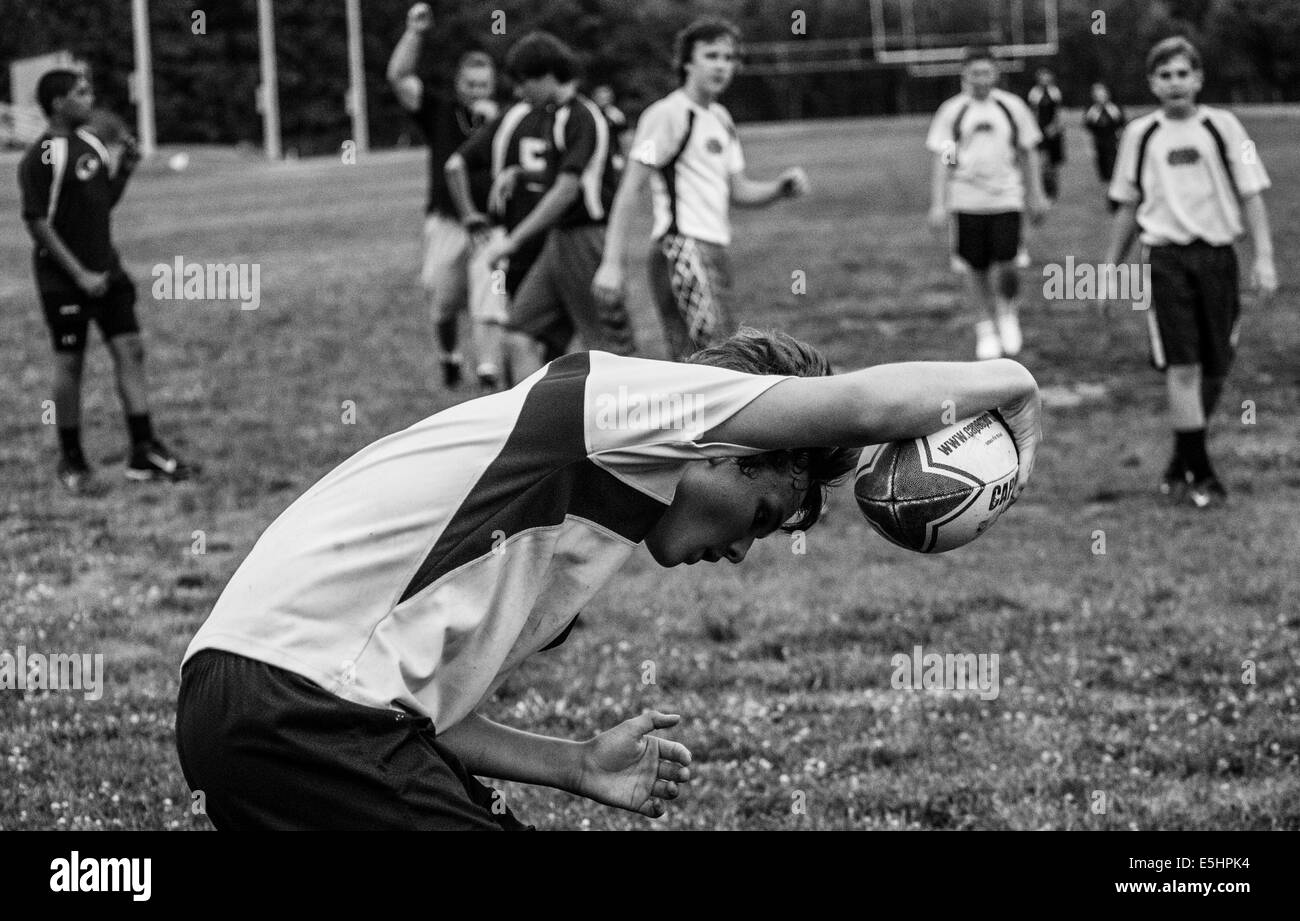 Rugby players practice and play coed rugby. They are young and weak but they have the heart of Billy goat. I am - Stock Image