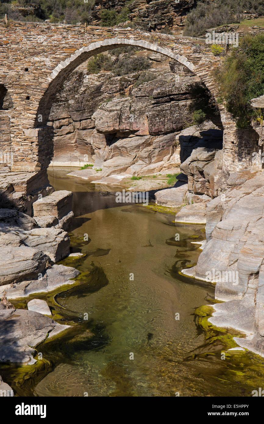 Historical stone bridge over Gediz River Kula Manisa Turkey - Stock Image