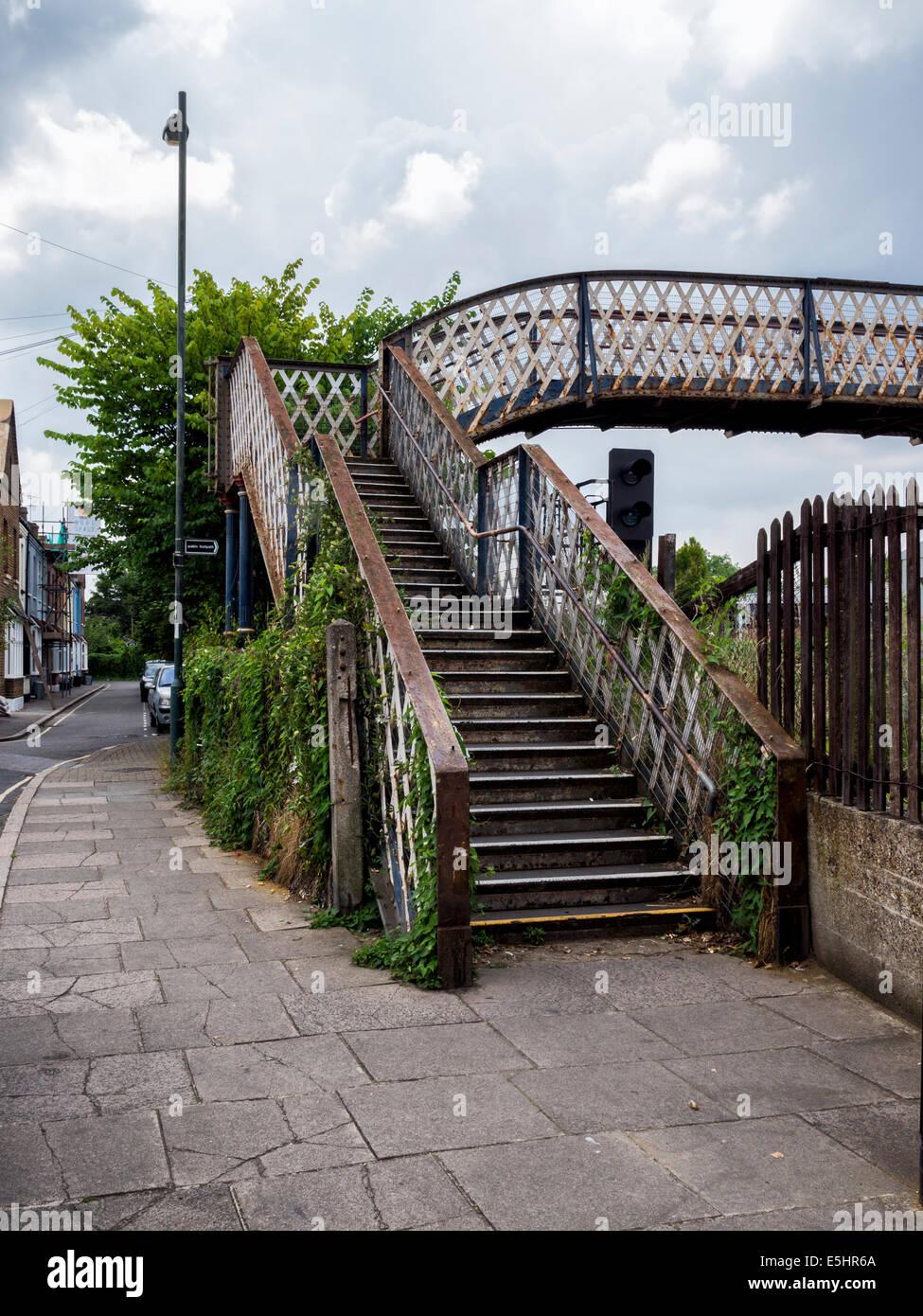 Pedestrian bridge over the railway lines at St. Margaret's rail Station, Greater London, UK - Stock Image