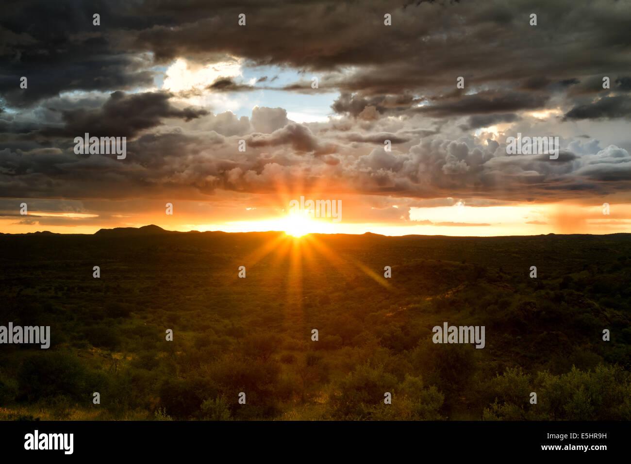 Sunset behind a thunderstorm, Savannah near Windhoek, Namibia - Stock Image