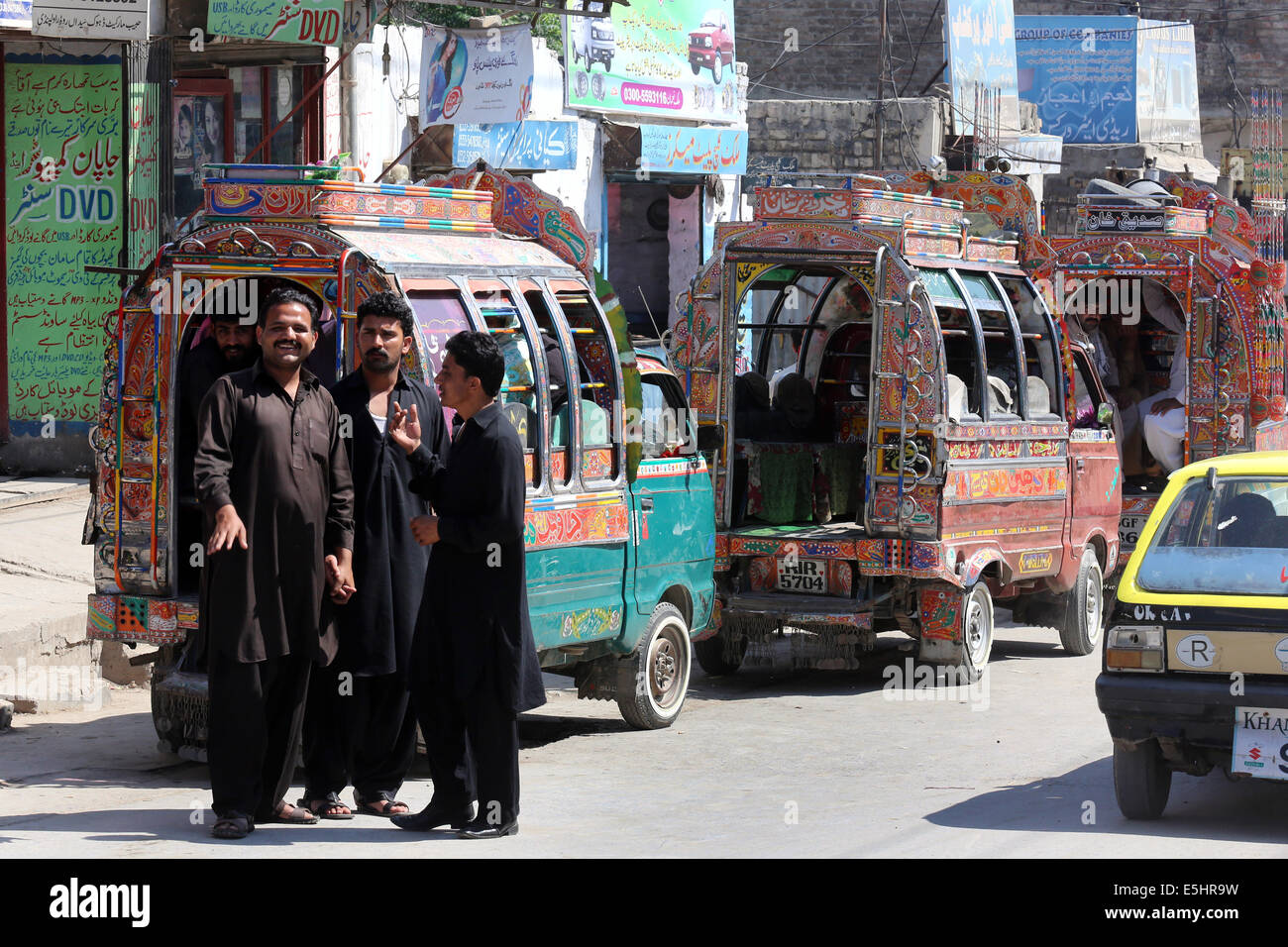 Colorful decorated mini busses, taxi cabs, public transport in Rawalpindi, Pakistan - Stock Image