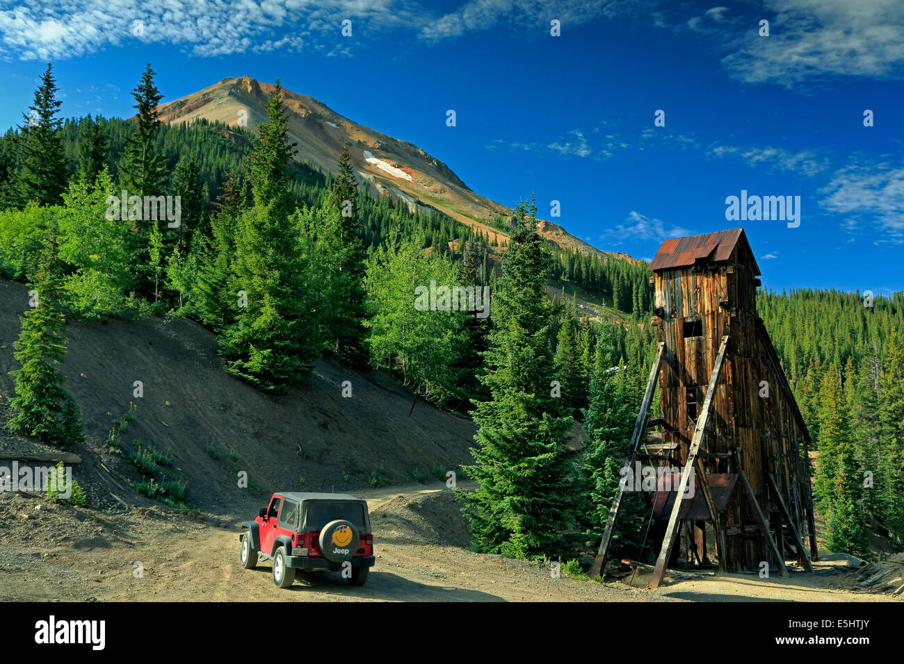 Jeep, shaft house and Red Mountain No. 3, Yankee Girl Mine, near Ouray, Colorado USA - Stock Image