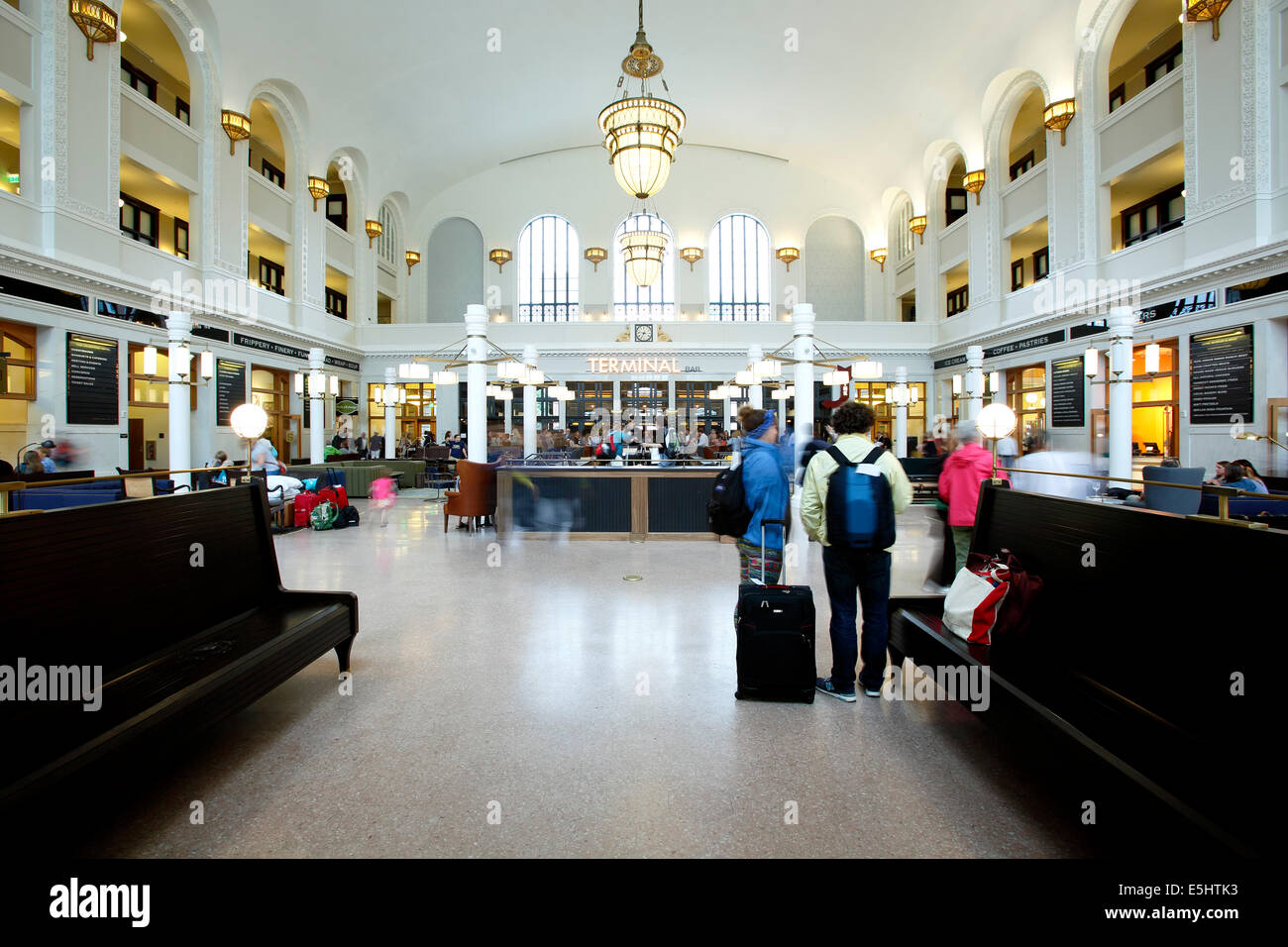 Group of travelers in terminal (Crawford Hotel, upper floors), Union Station, Denver, Colorado USA - Stock Image