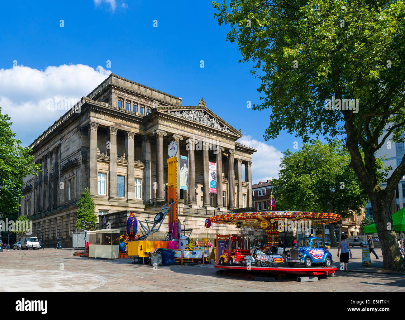 Fairground rides in front of the Harris Museum and Art Gallery, Market Square, Preston, Lancashire, UK - Stock Image