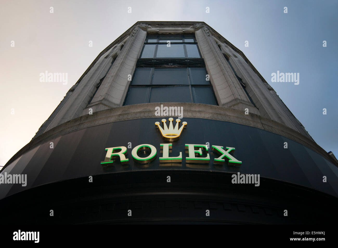 rolex shop dealer dealers watch watches salesman retail - Stock Image