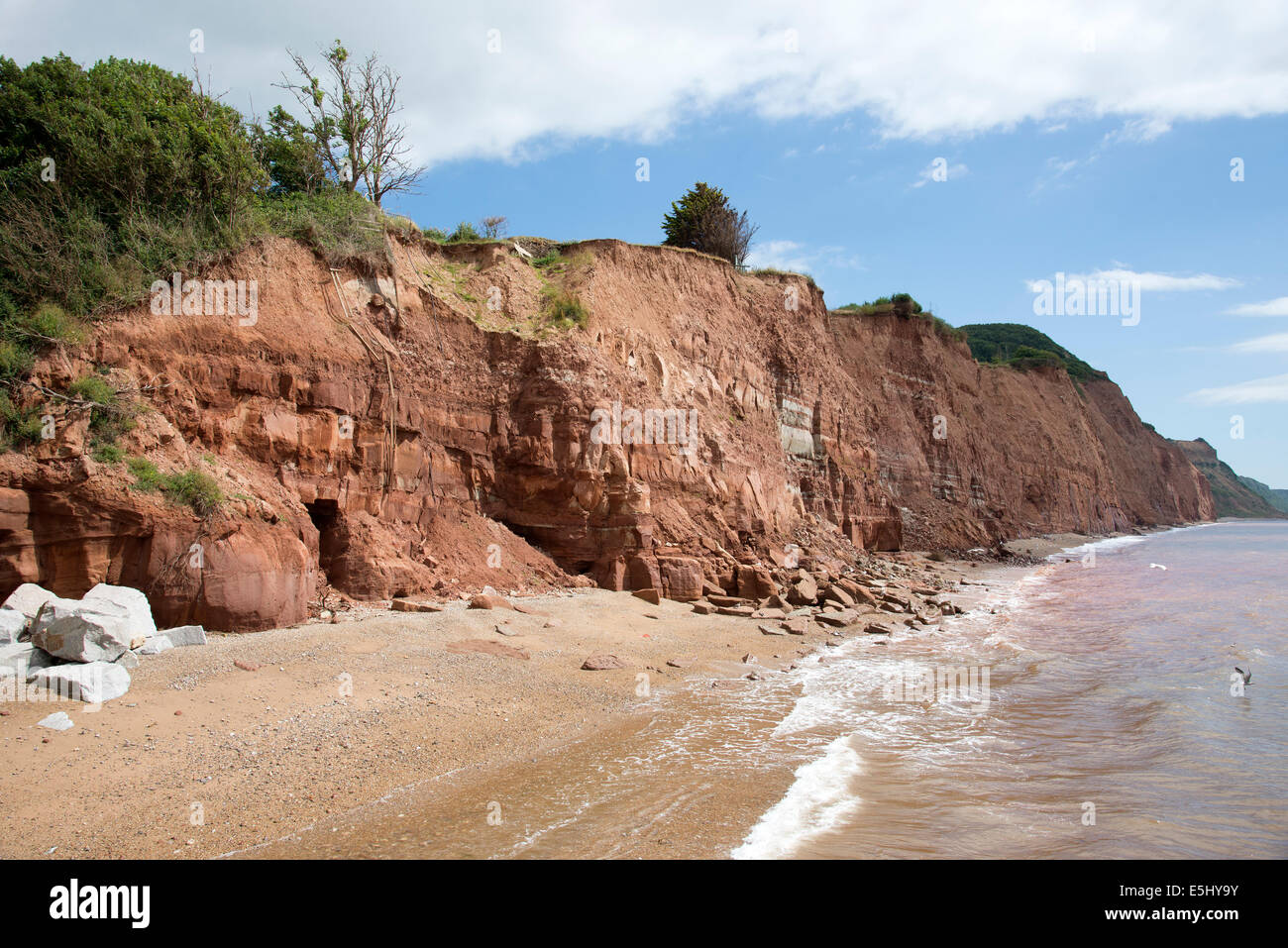 Cliff fall on The Jurassic coast at Sidmouth Devon England UK Rock and earth sliding into the sea - Stock Image