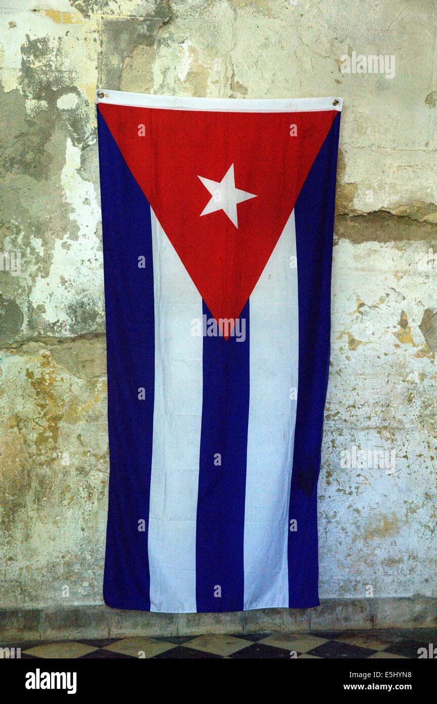 Cuban flag hanging on patina style wall - Stock Image