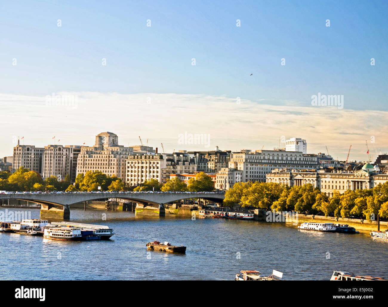 View of the River Thames showing Waterloo Bridge and Shell Mex House, London, England, United Kingdom Stock Photo