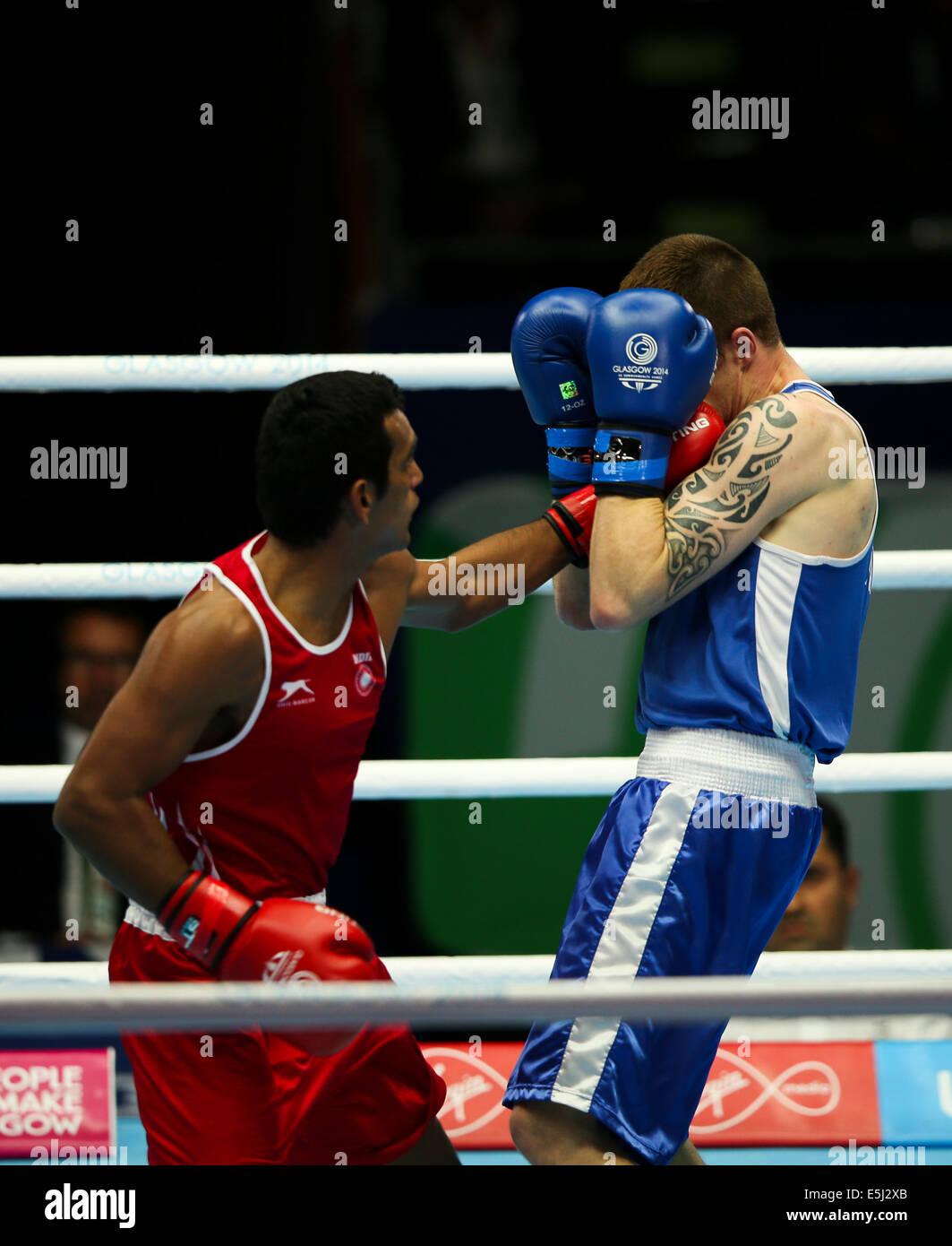 Scotstoun, Glasgow Scotland 1 Aug 2014. Day 9 Boxing semi-finals. Mandeep Jangra IND beats Steven Donnelly NIR Credit: - Stock Image