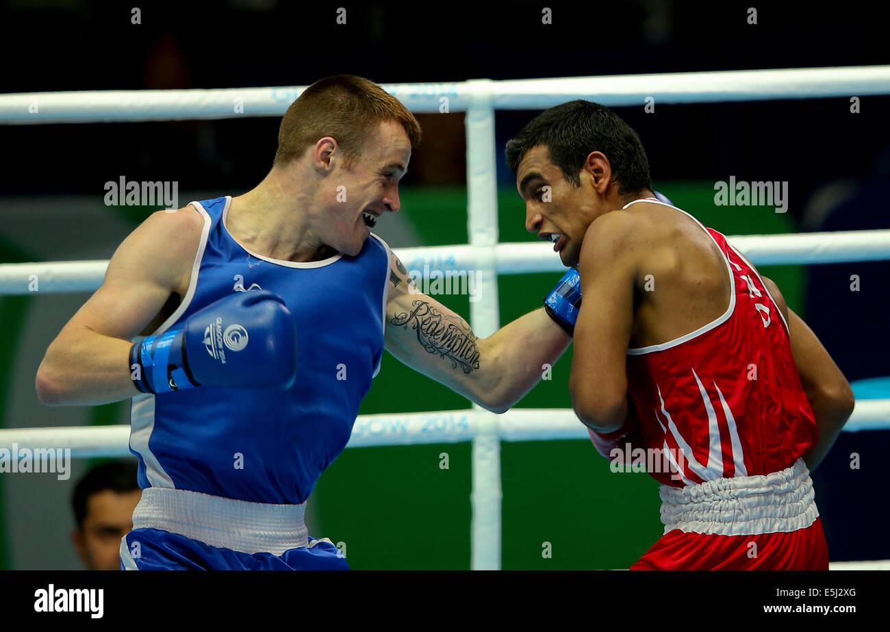 Scotstoun, Glasgow Scotland 1 Aug 2014. Day 9 Boxing semi-finals.  Mandeep Jangra IND beats Steven Donnelly NIR - Stock Image