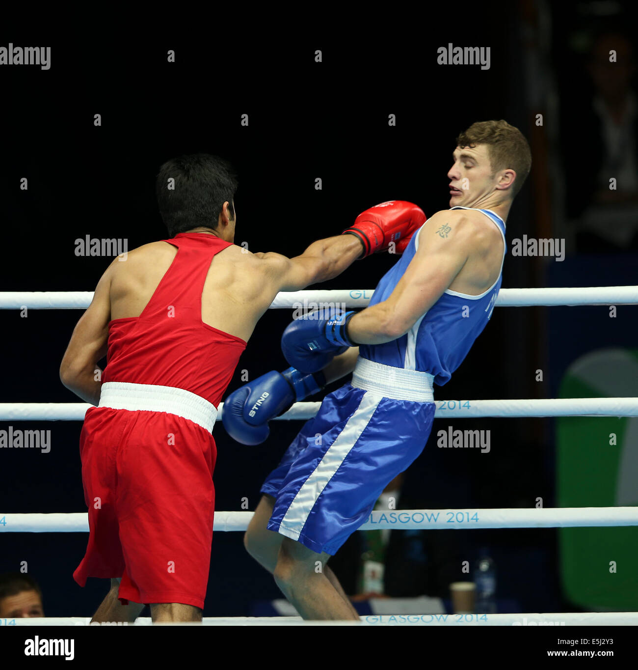 Scotstoun, Glasgow Scotland 1 Aug 2014. Day 9 Boxing semi-finals.  Vijender Vijender IND beats Connor Coyle NIR - Stock Image