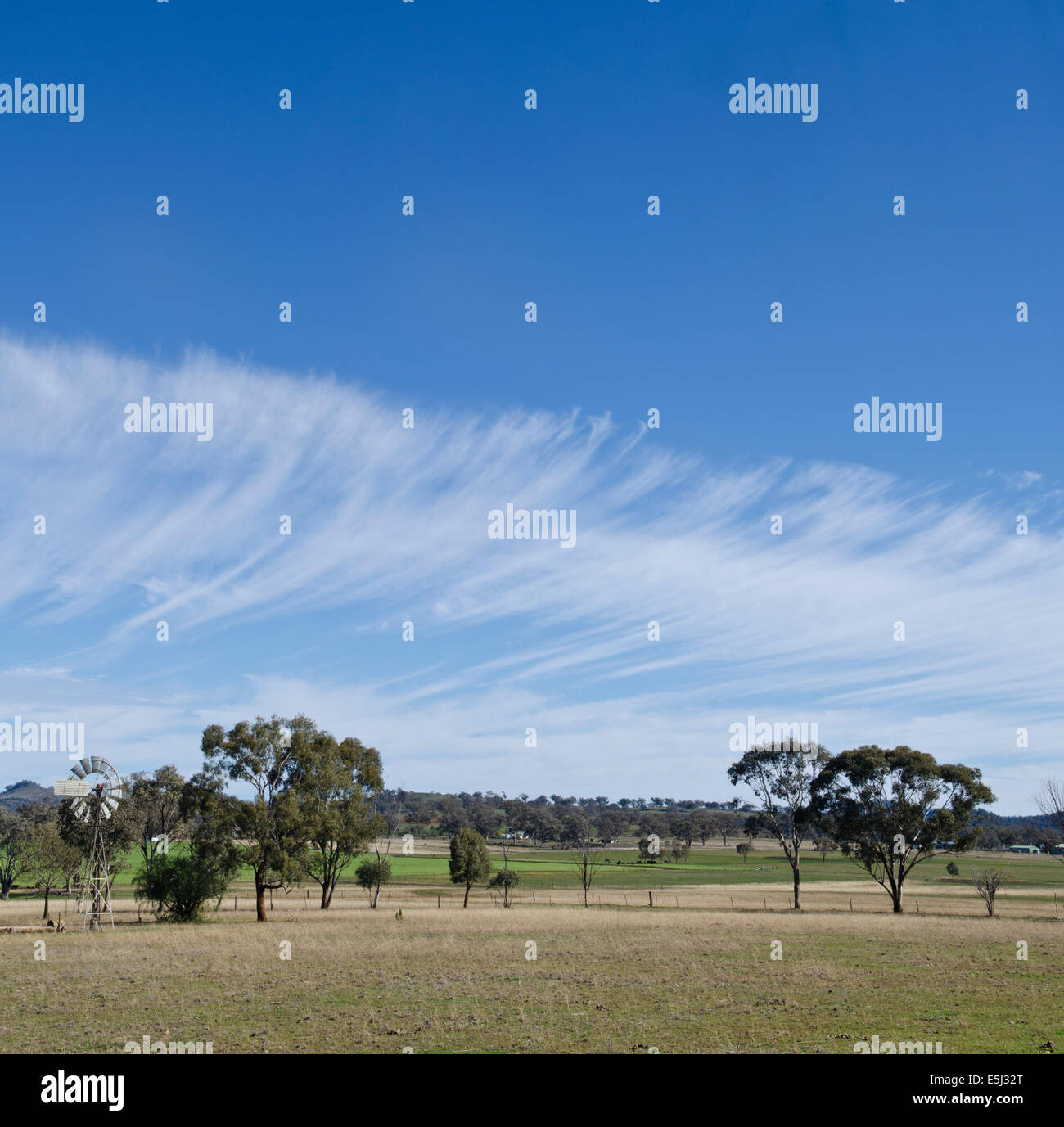 A front of cirrus cloud approaching farm lands at Tamworth NSW Australia - Stock Image