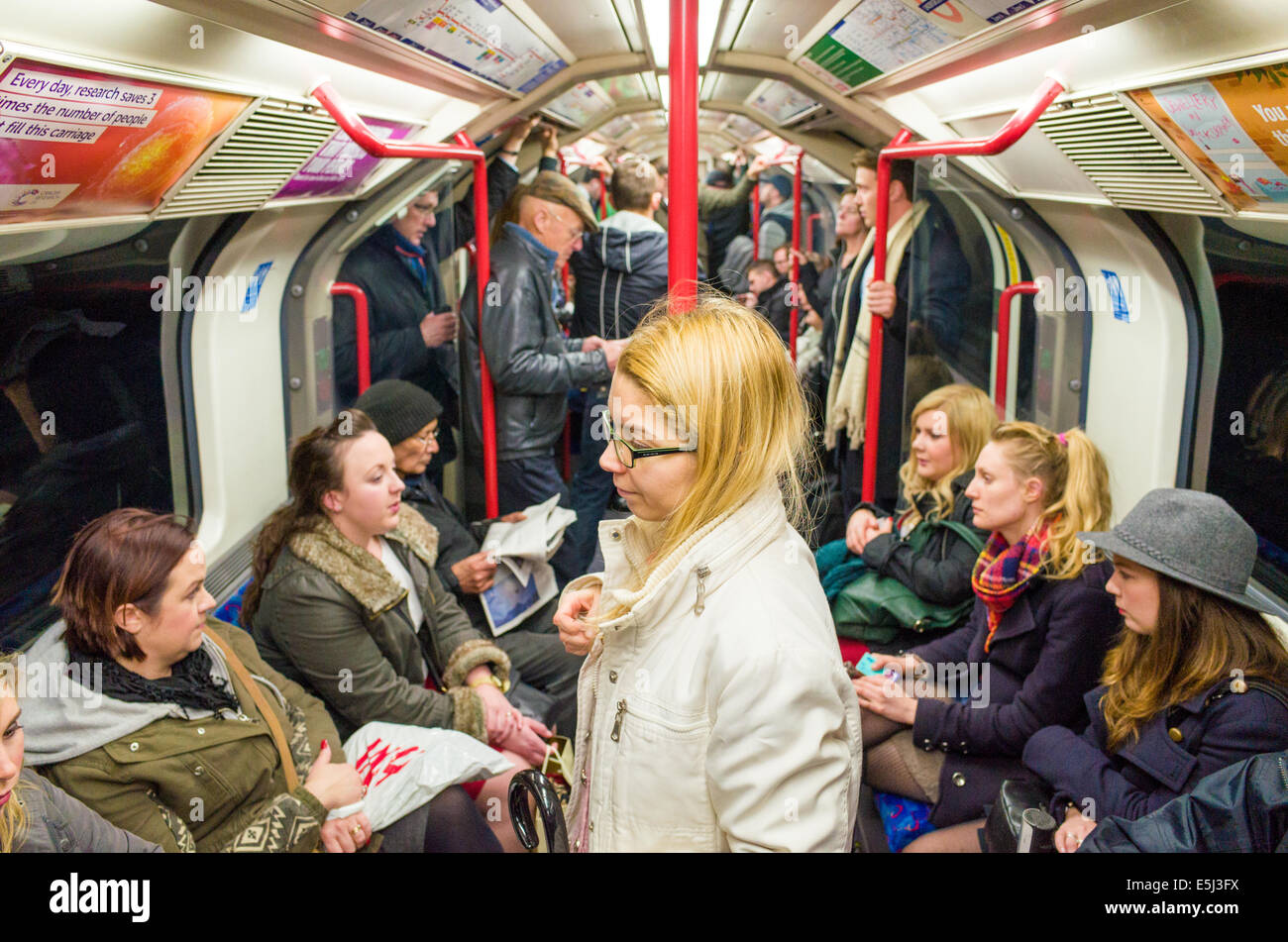 Passengers on Central Line carriage of London Underground train, England, UK - Stock Image