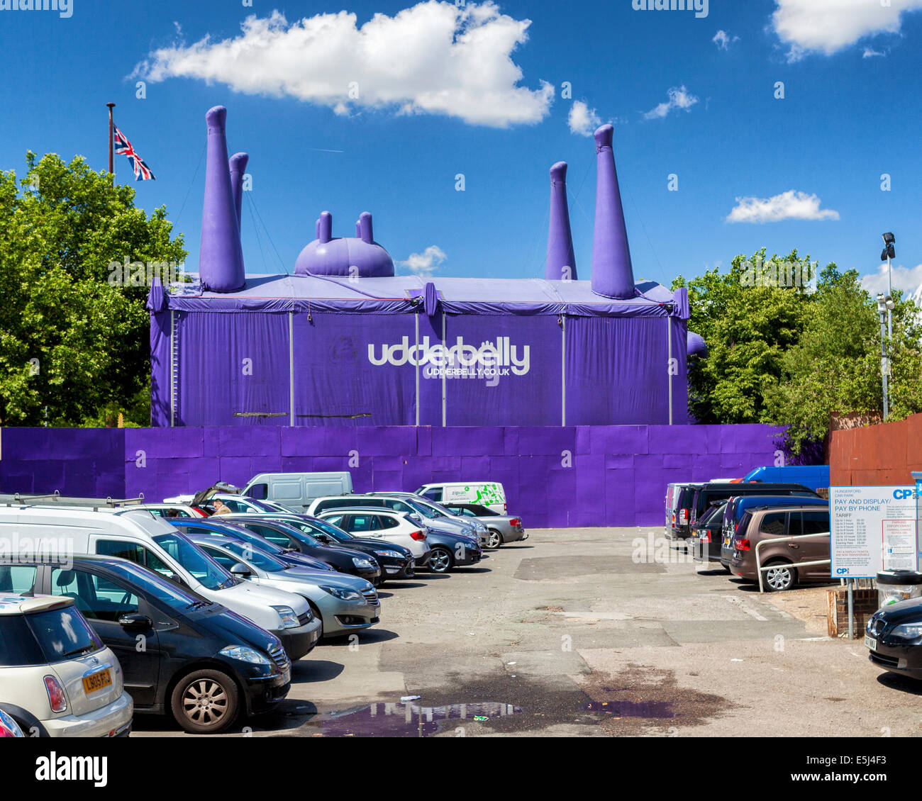 The Udderbelly tent - purple inverted cow with udders and legs in the air - entertainment venue on the South Bank, - Stock Image