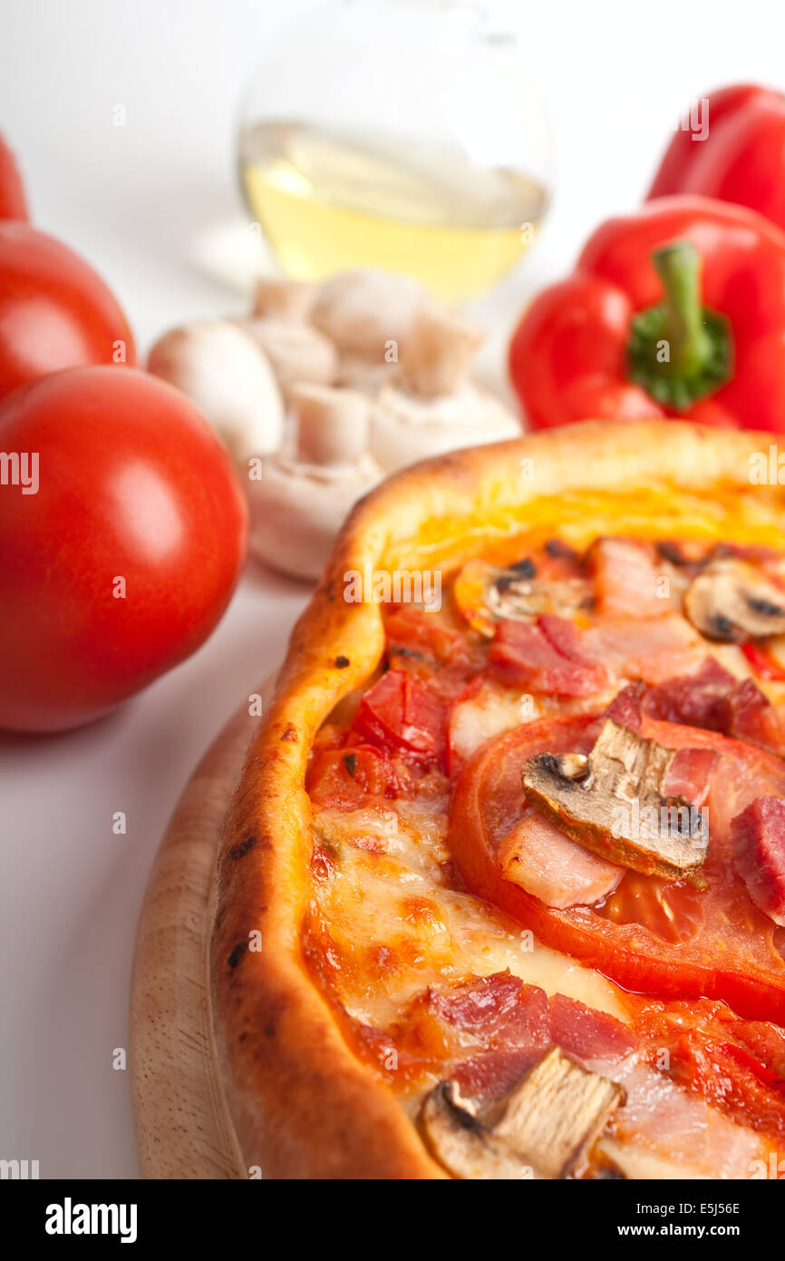 Ham and Mushroom Pizza with Ingredients Stock Photo