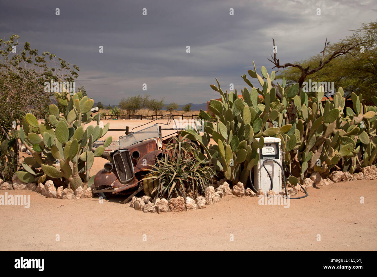 car wreck and old gas station in the desert of Solitaire, Namibia, Africa Stock Photo