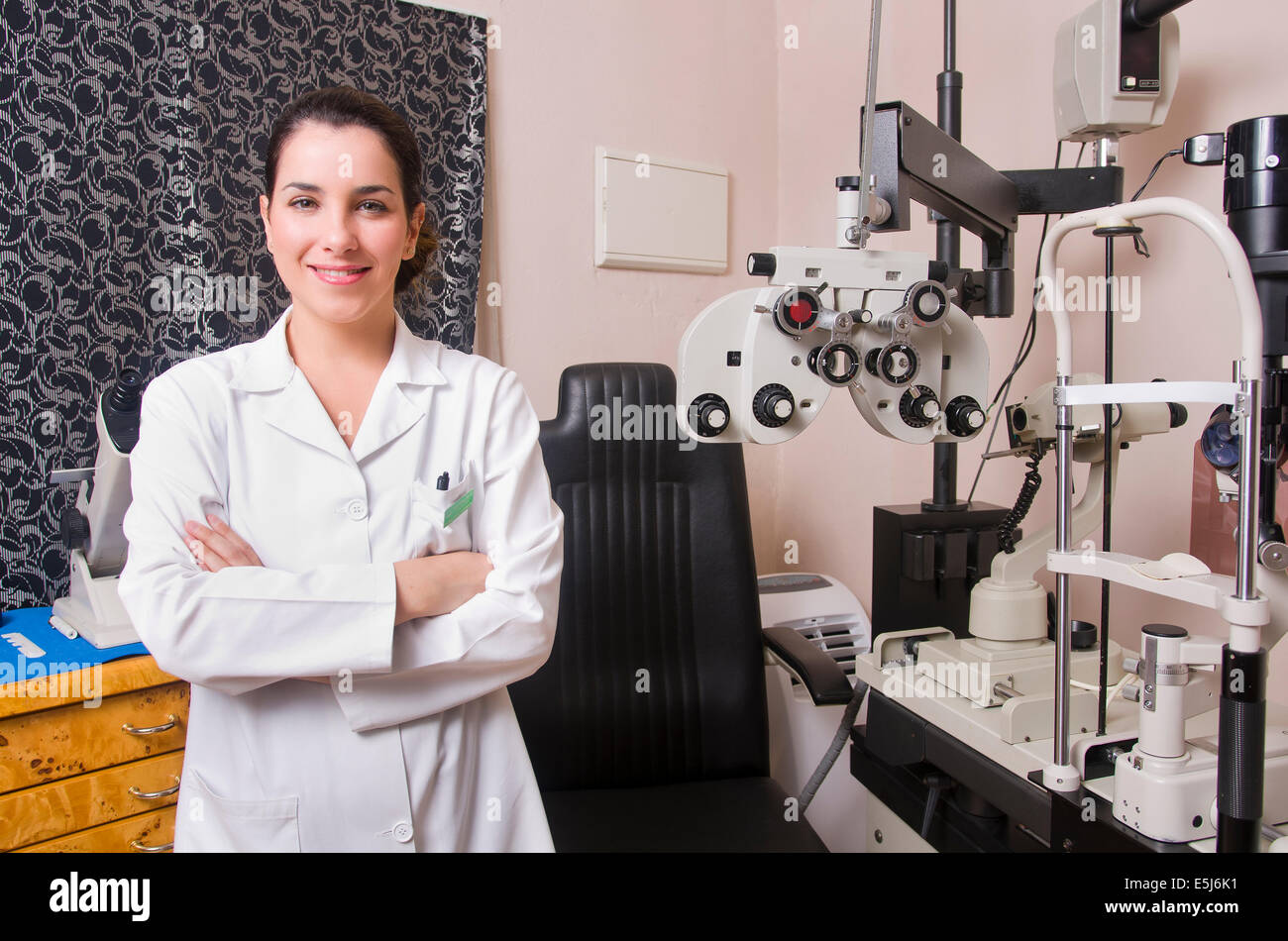 Optometrist chair, ophtalmology diopters calibration in oculist lab of young woman doctor. - Stock Image