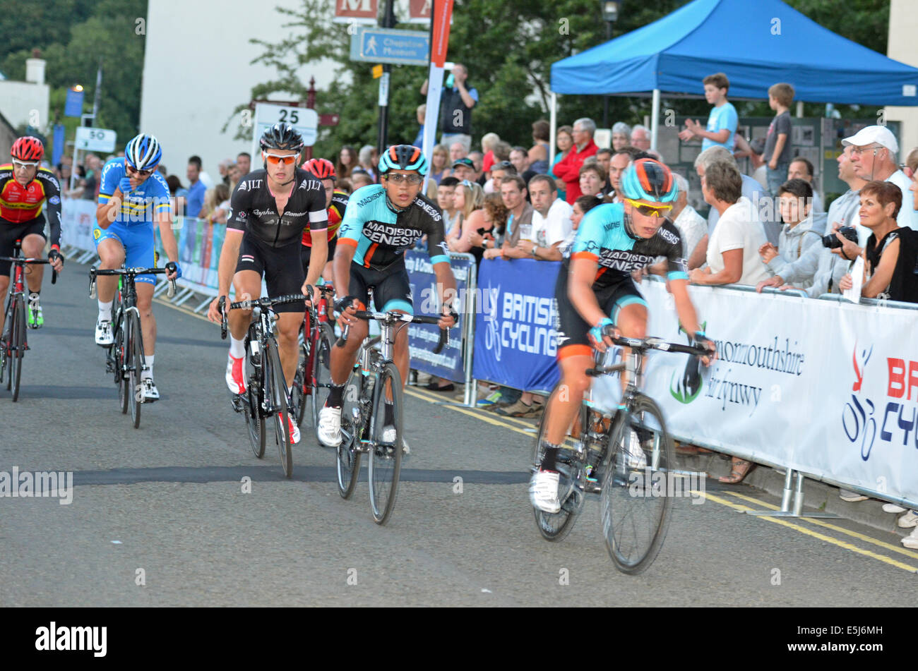 Town Center Cycling in Chepstow in Wales. The Wales Open Criterium, consisting of Elite riders racing over a 1.17 - Stock Image