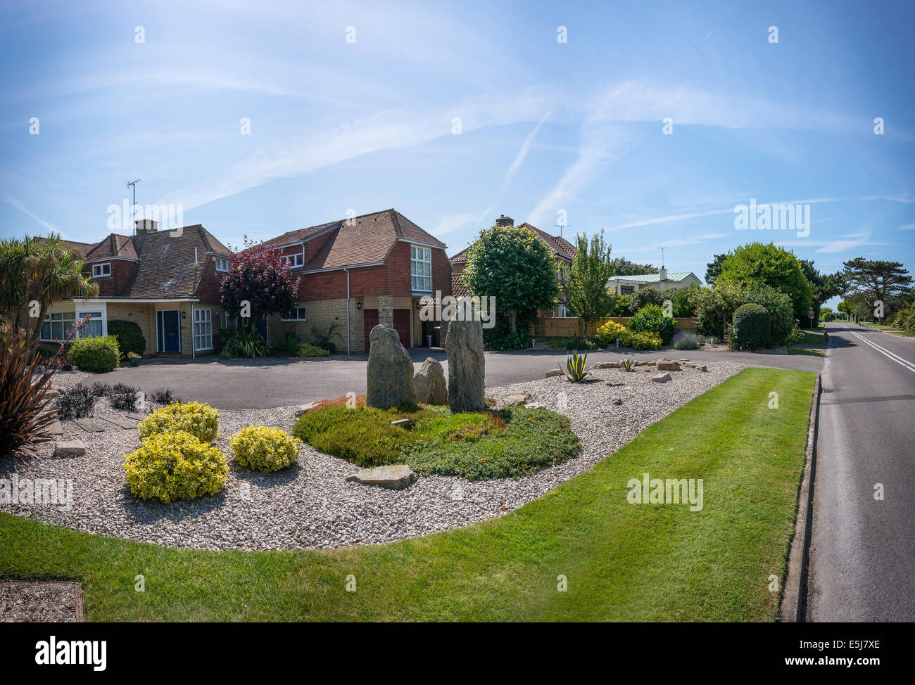 Modern standing stones in a posh suburb between Worthing and Littlehampton, West Sussex, UK - Stock Image