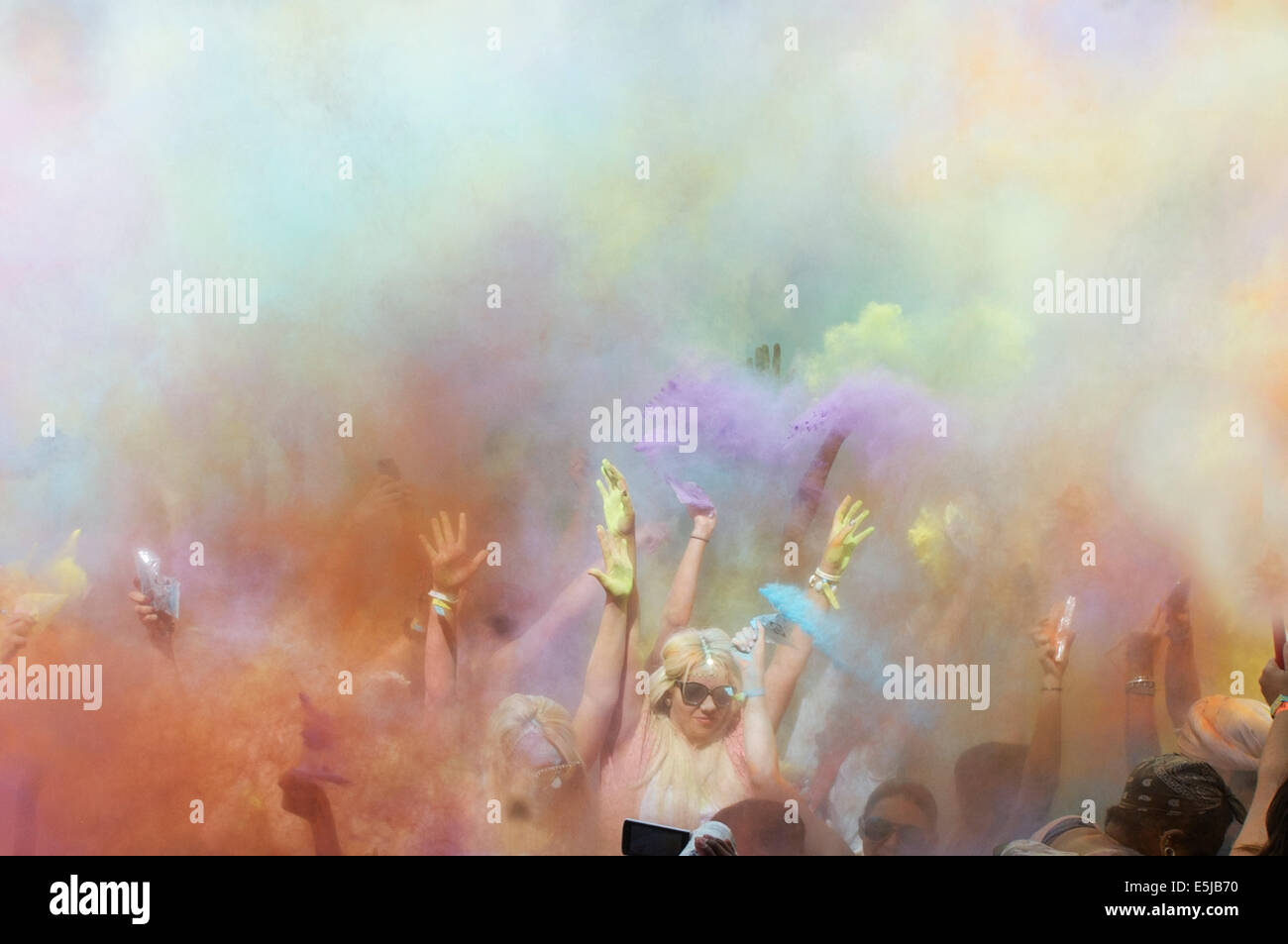 London, UK. 2nd Aug, 2014. Wembley Park.Holi One Festival.Pic Shows Festival Goers and the powder drop Credit:  - Stock Image