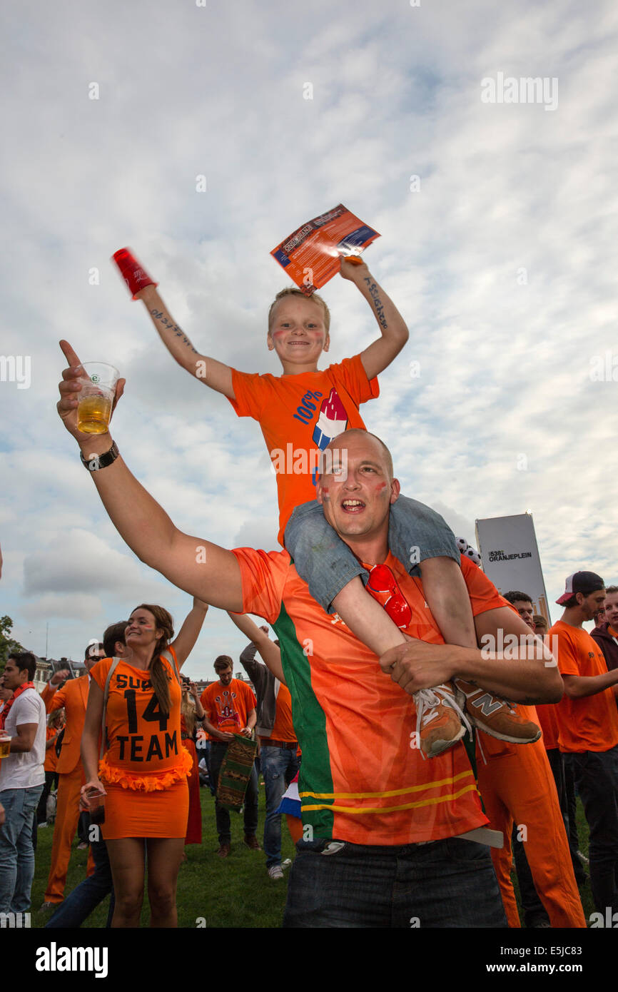 Netherlands, Amsterdam, World Cup Football. Spain - The Netherlands. Museumplein. Supporters gathering. Father and - Stock Image
