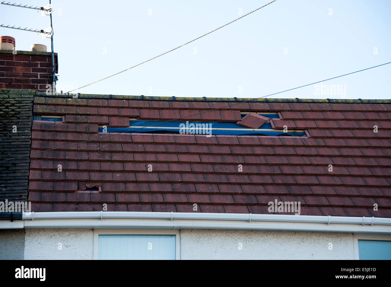 Roof storm Damage Slates blown off insurance claim - Stock Image