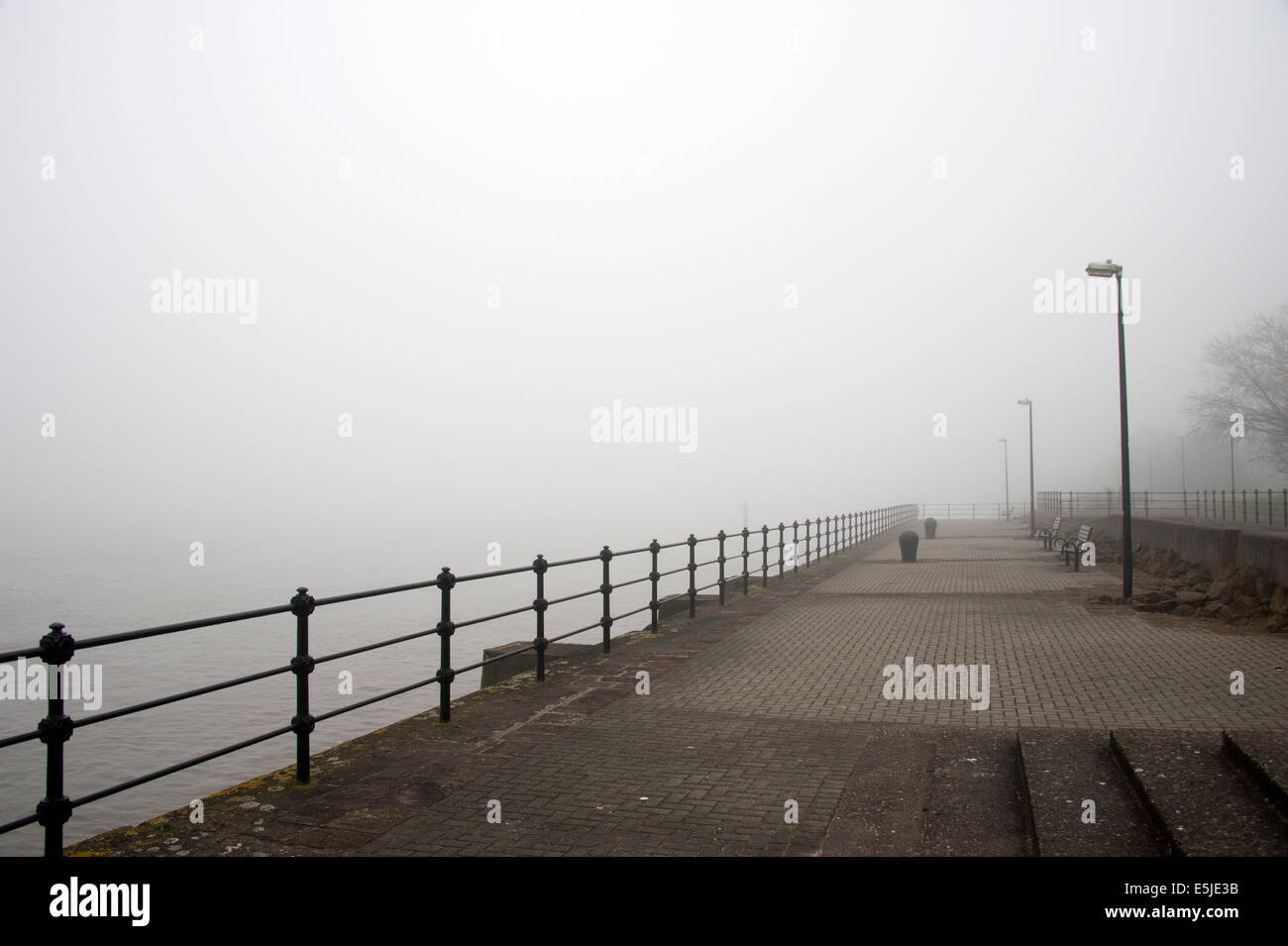 sea mist fog thick railings disappear in to - Stock Image