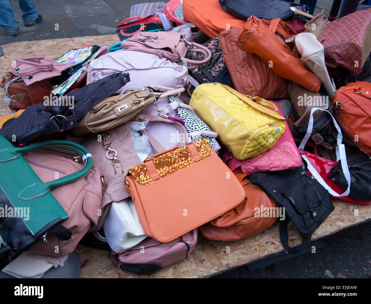 082fad43f89b4 Pile of used worn secondhand bags handbags for sale Stock Photo ...