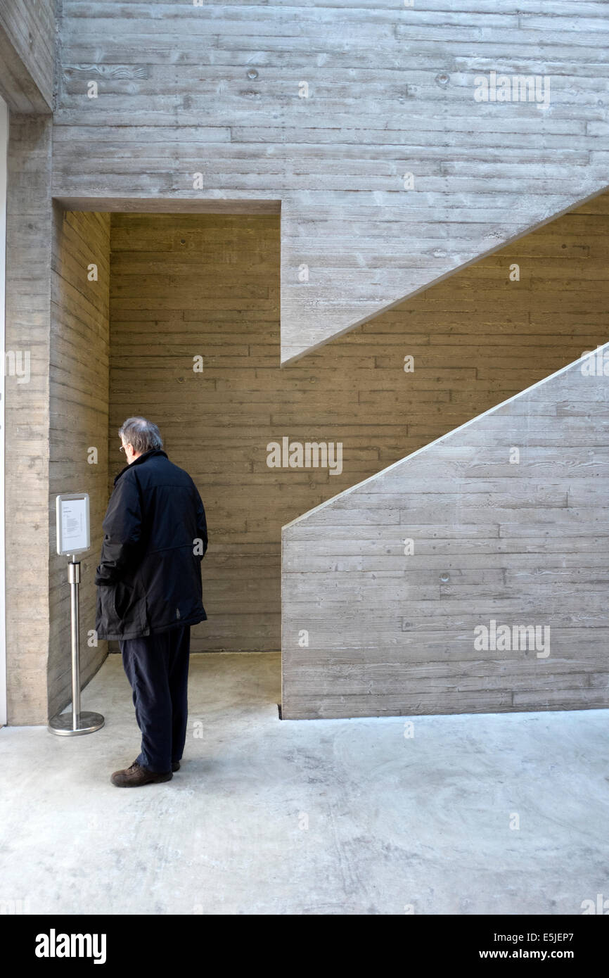 Man standing modern concrete architecture angular - Stock Image