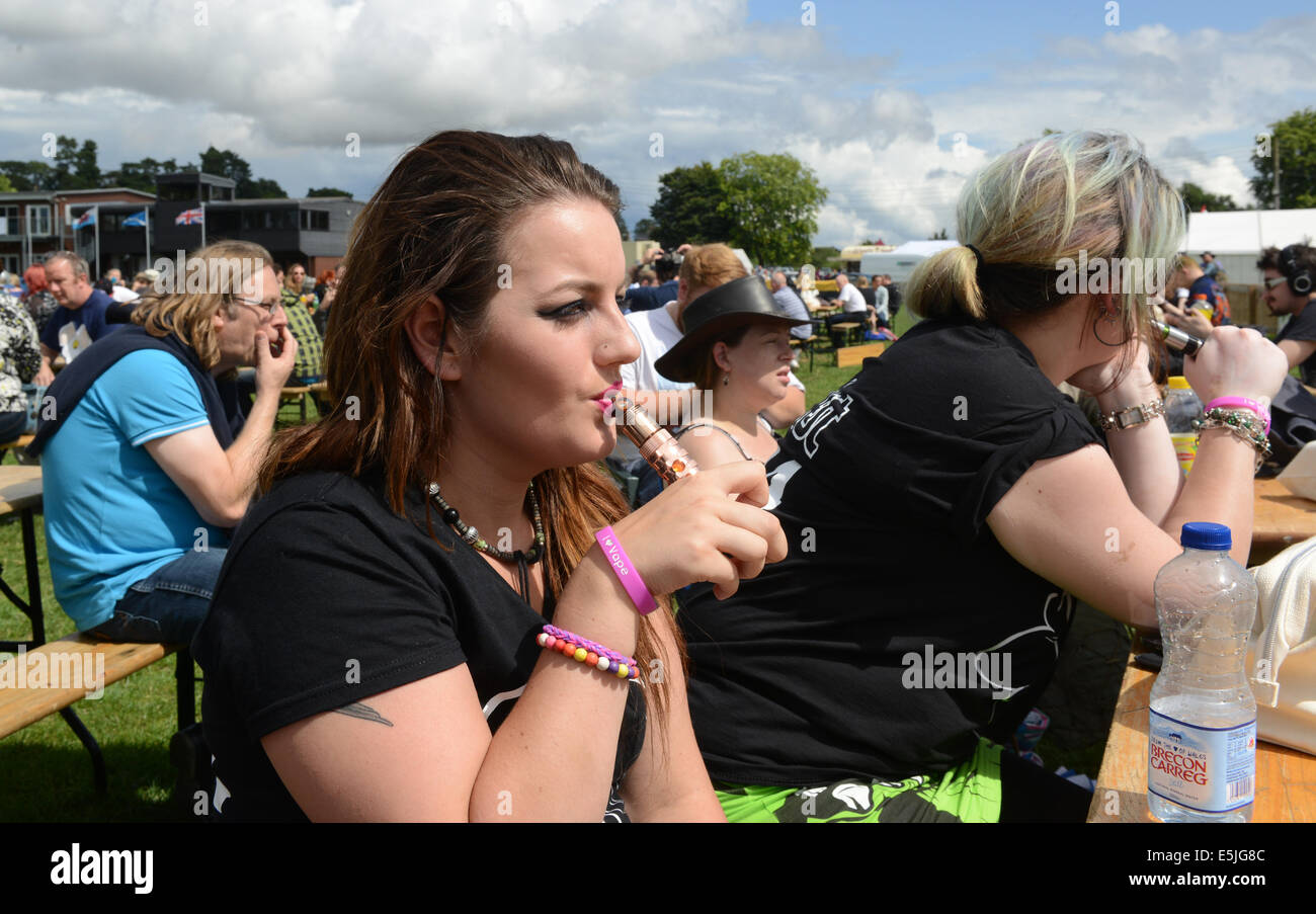 A young woman puffing on her vapouriser at the 2nd annual Vapour Festival. Credit:  David Bagnall/Alamy Live News - Stock Image