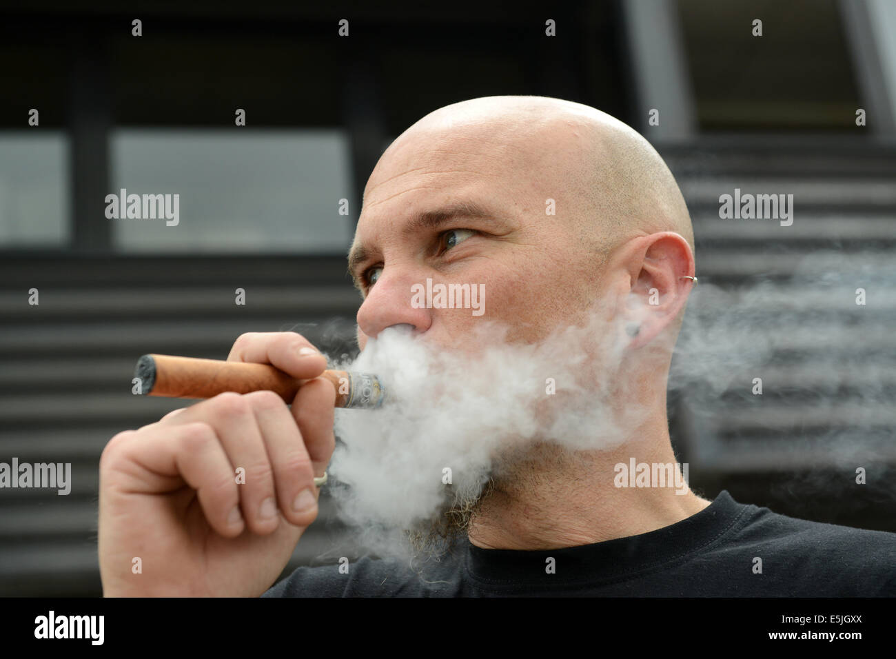 Ross Wareham of Dublin puffs on his cigar style vapouriser at the 2nd annual Vapour Festival. Credit:  David Bagnall/Alamy - Stock Image