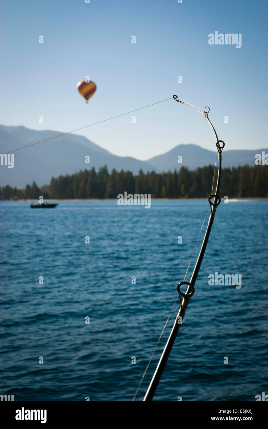 Balloon rising over Lake Tahoe, Nevada USA Stock Photo
